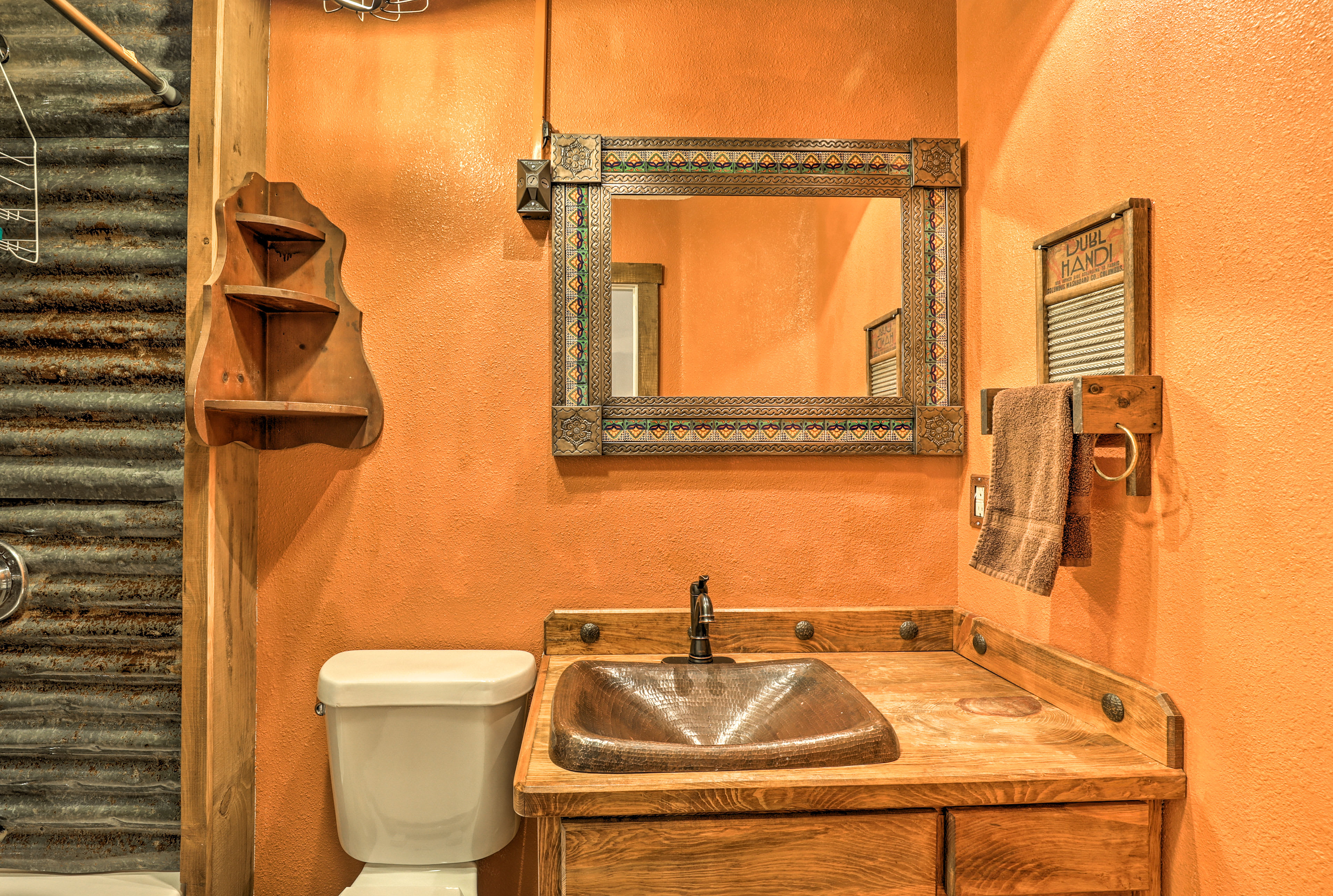 Wash up at this vanity with a artistic vessel sink.