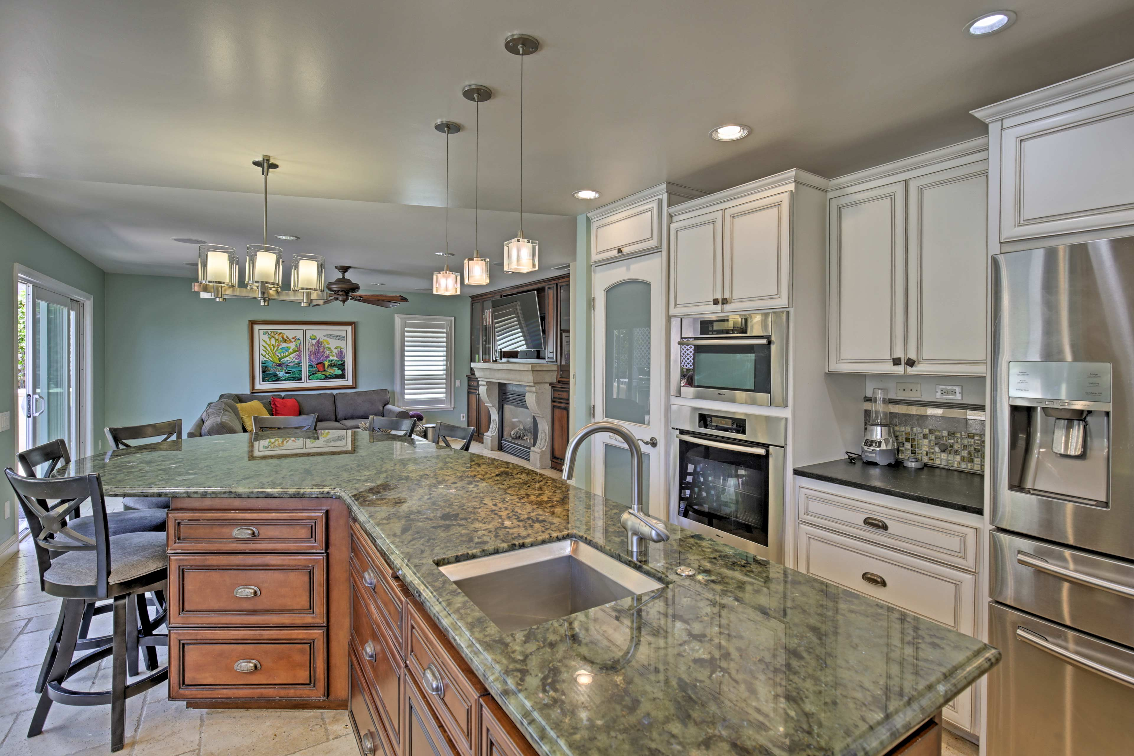 Modern appliances and ample cookware create a fully equipped cooking space.