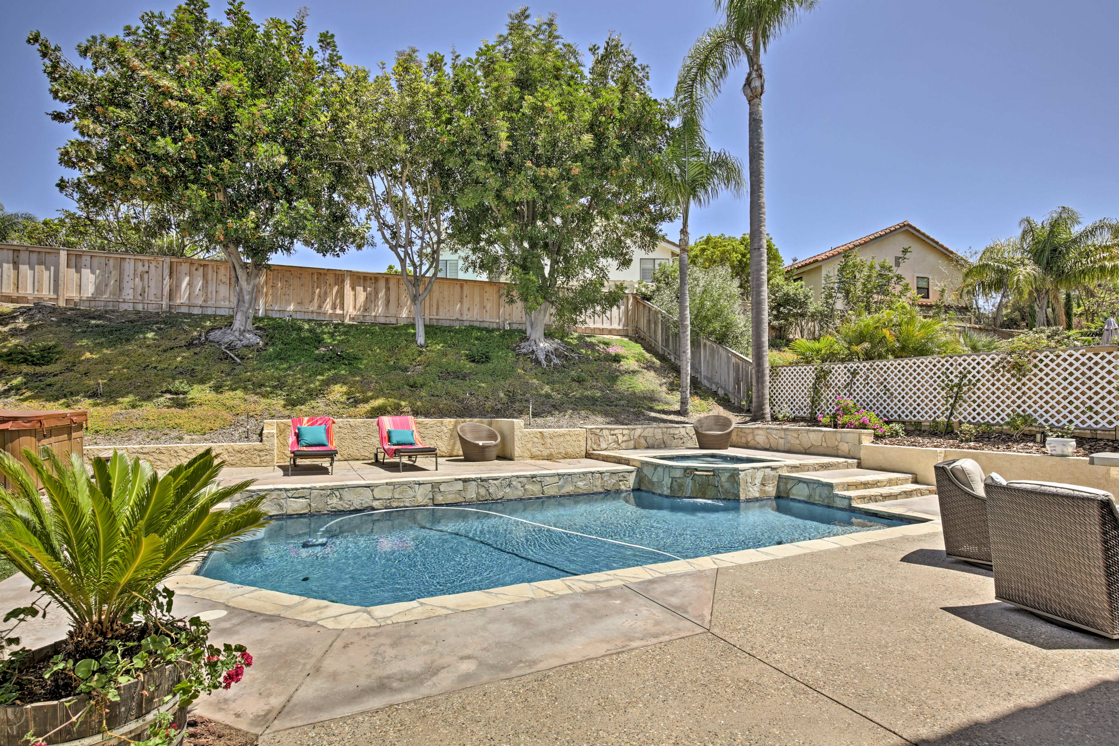 You'll fall in love with this home's backyard oasis and salt water pool!