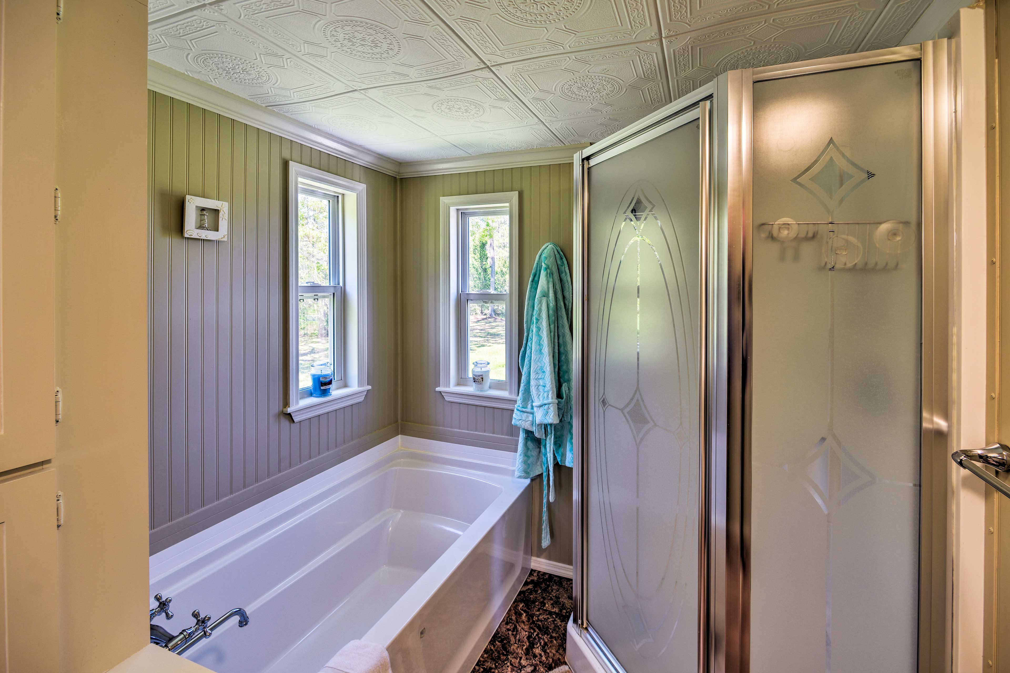 Rinse off in the walk-in shower or soak in the tub.