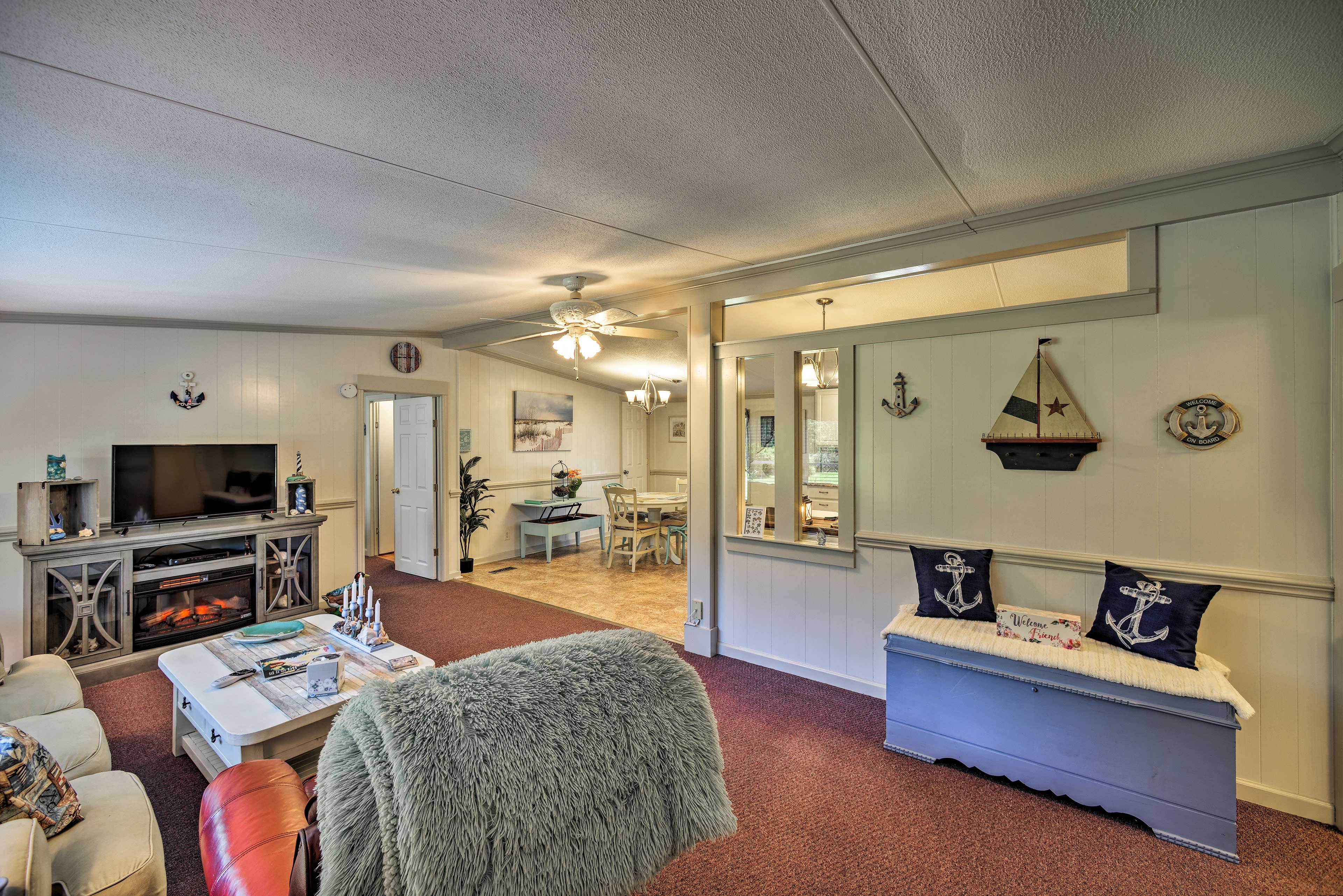 The living room offers a flat-screen cable TV and a new electric fireplace.