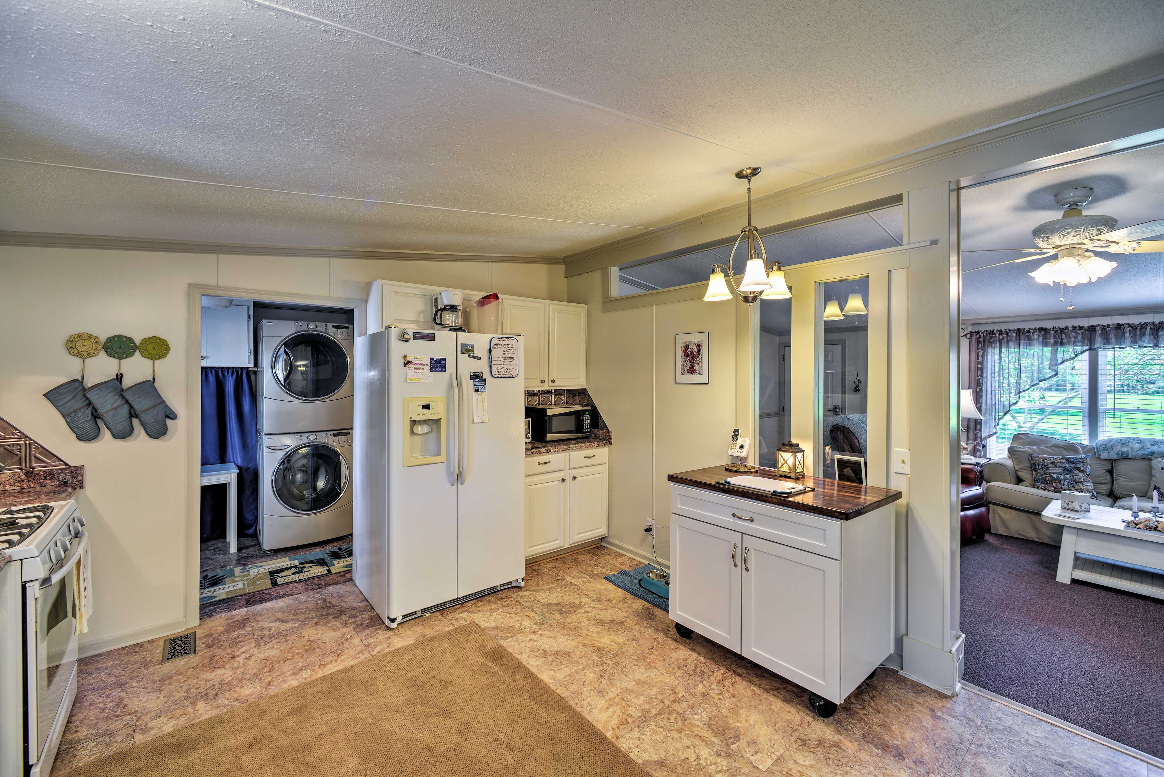 In-unit laundry machines just off the kitchen will keep your clothes fresh.