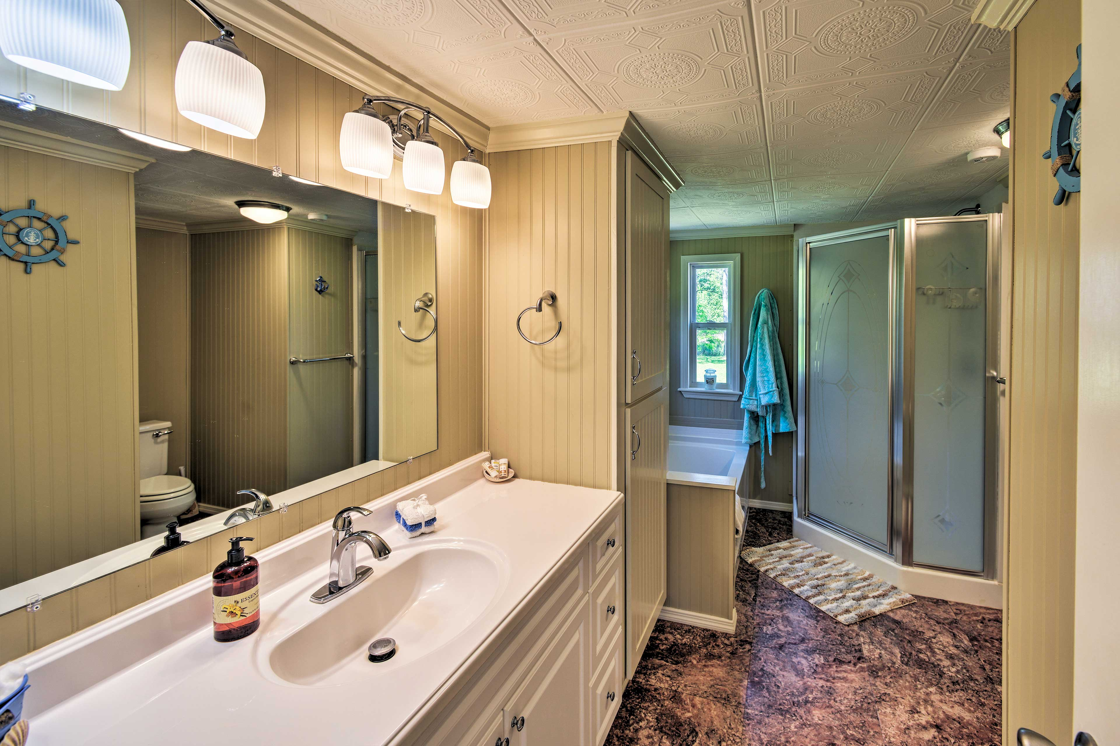 The spacious bathroom offers plenty of room for morning routines.