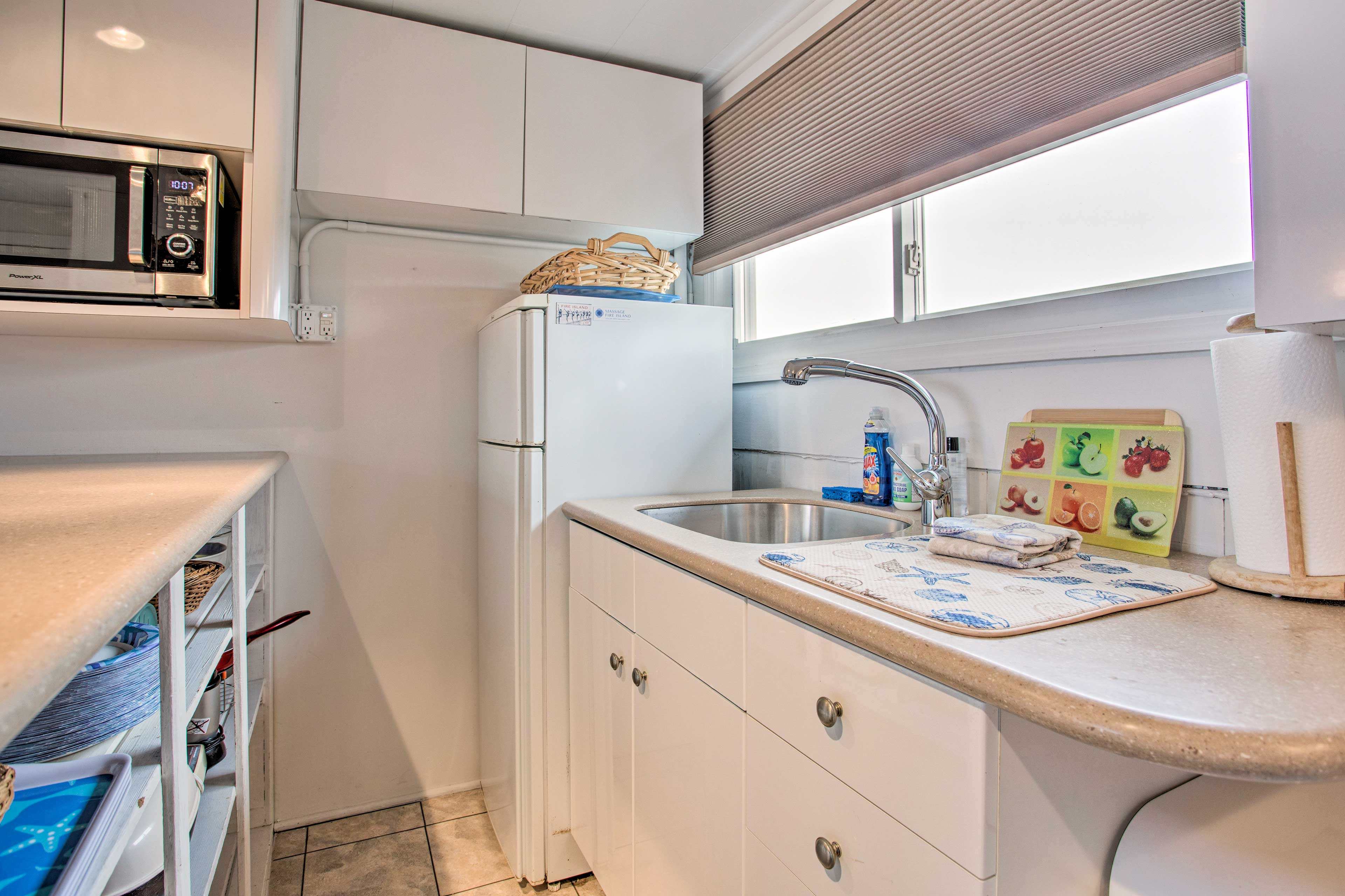 Meal time is a breeze in this well-equipped kitchen.