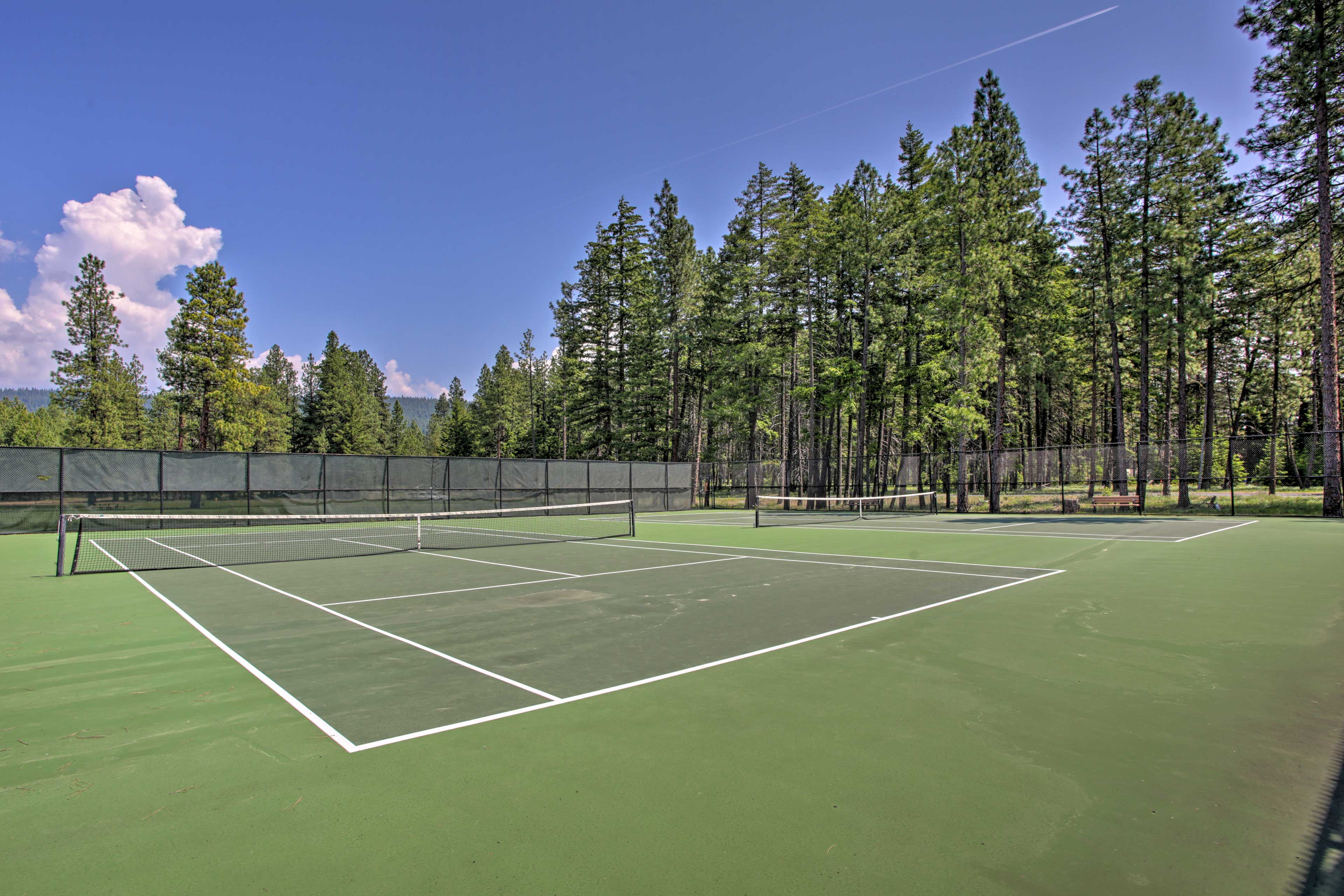 Challenge friends to a match of tennis.