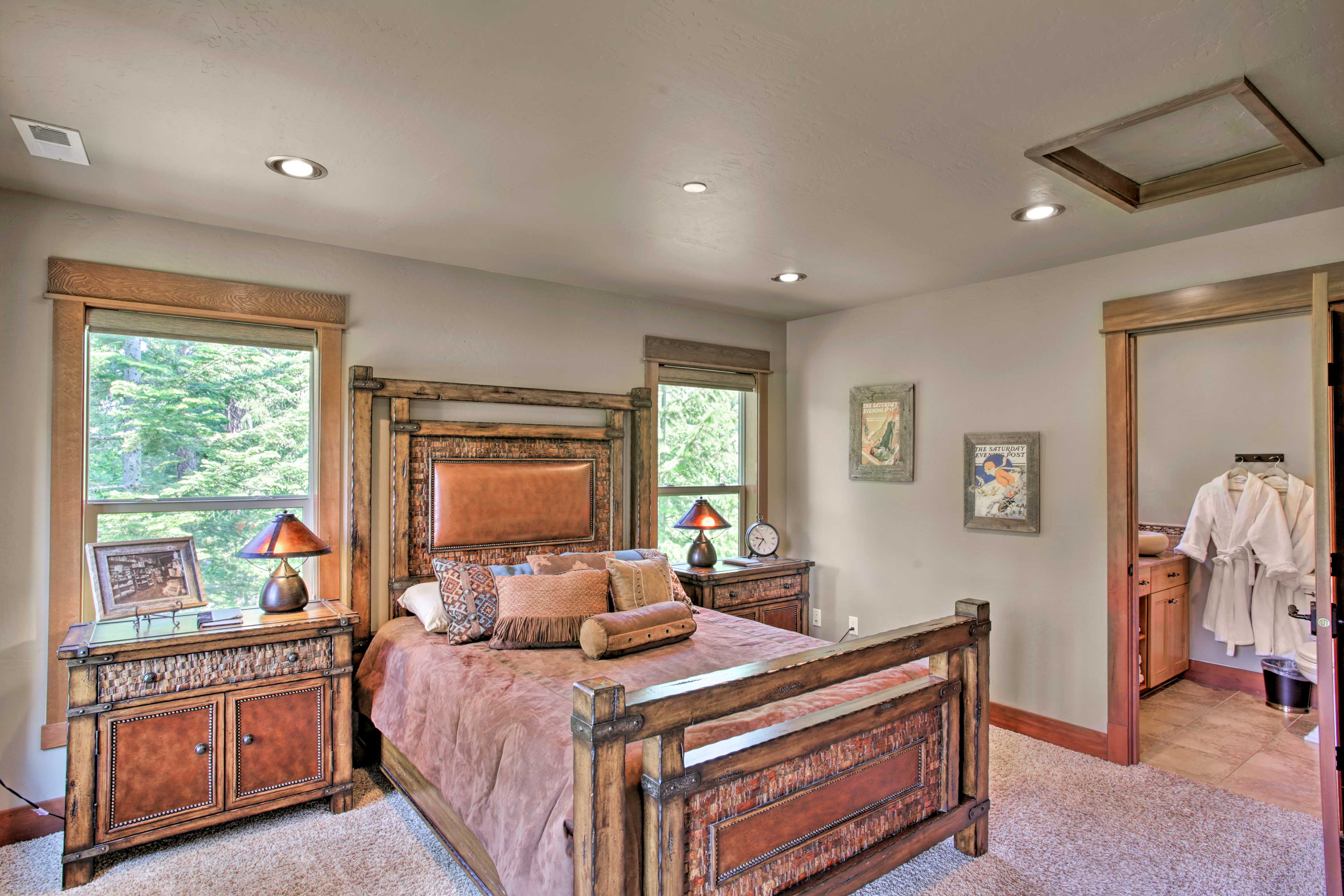 The upstairs master bedroom houses a queen bed.