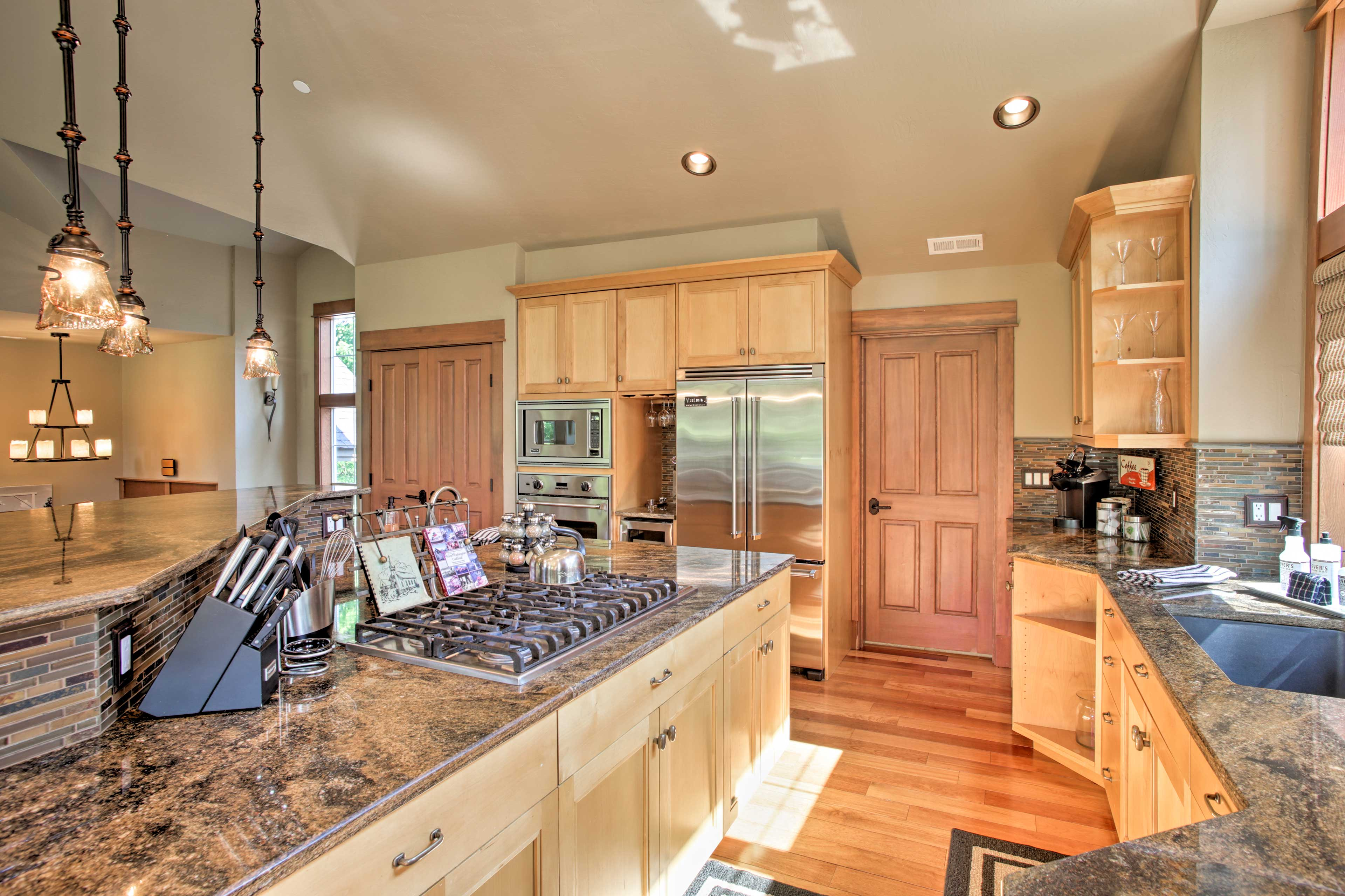 The kitchen comes fully equipped with state-of-the-art appliances.