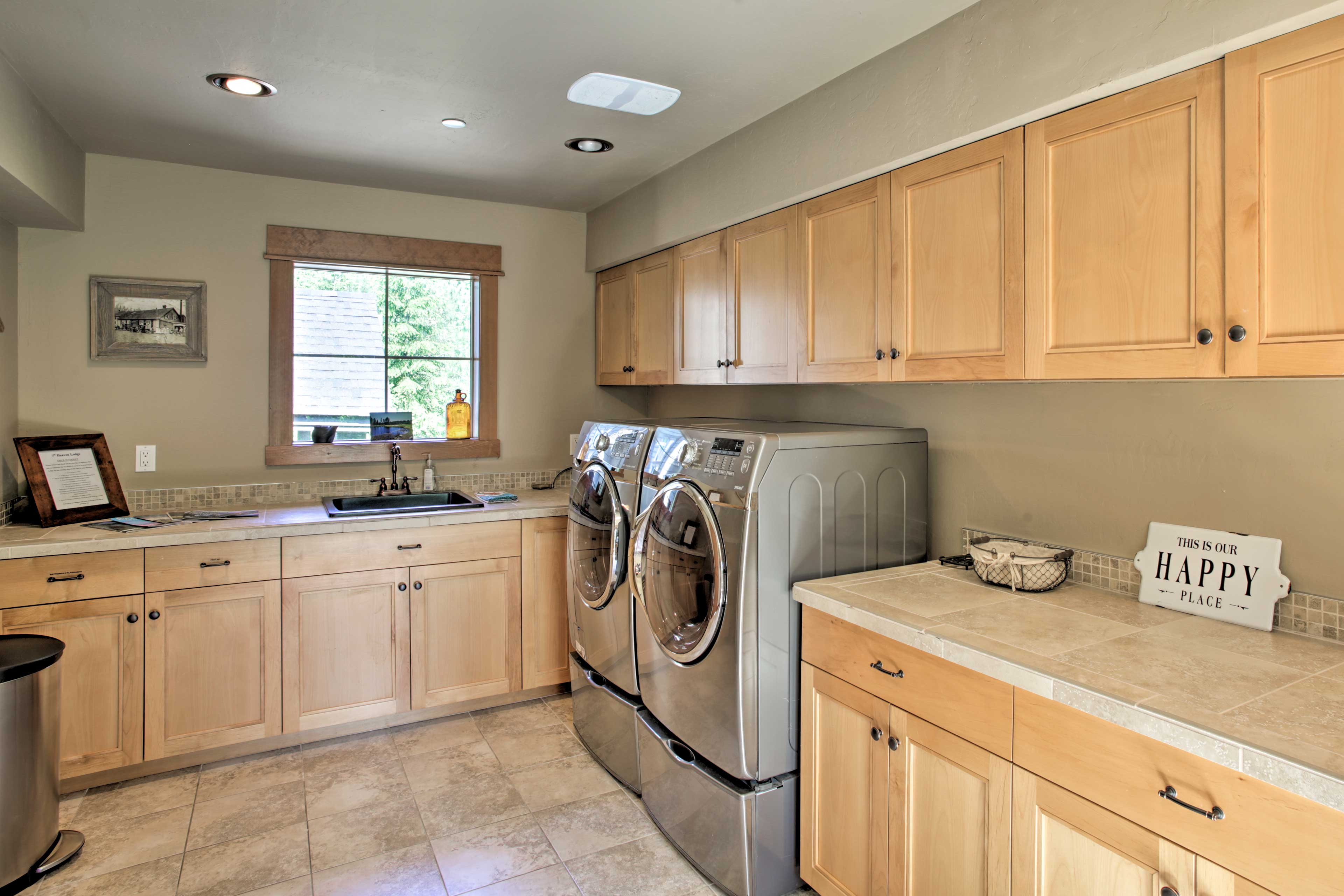 Pack light and take advantage of this spacious laundry room.