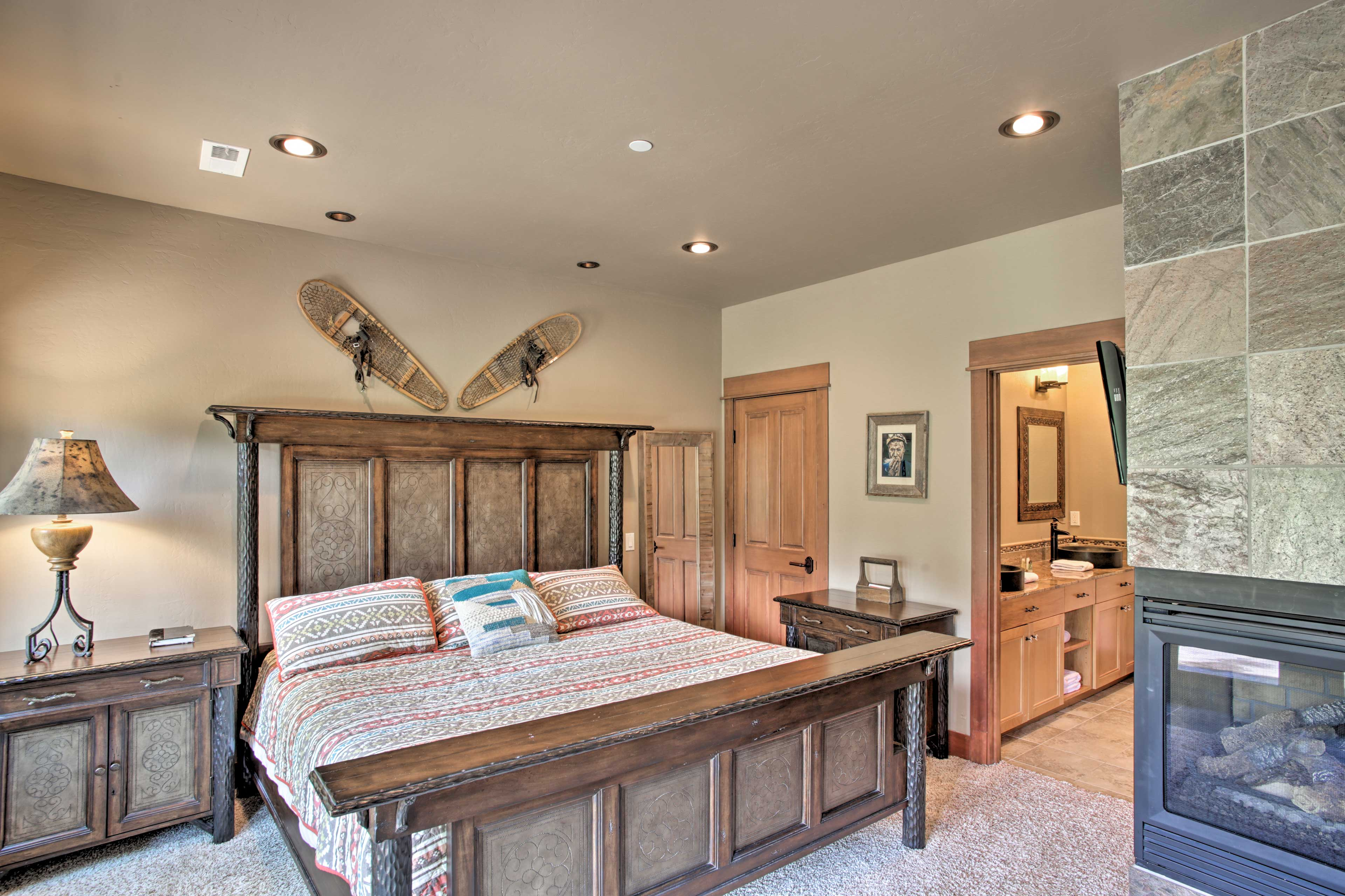 The second master suite boasts a king bed and gas fireplace.
