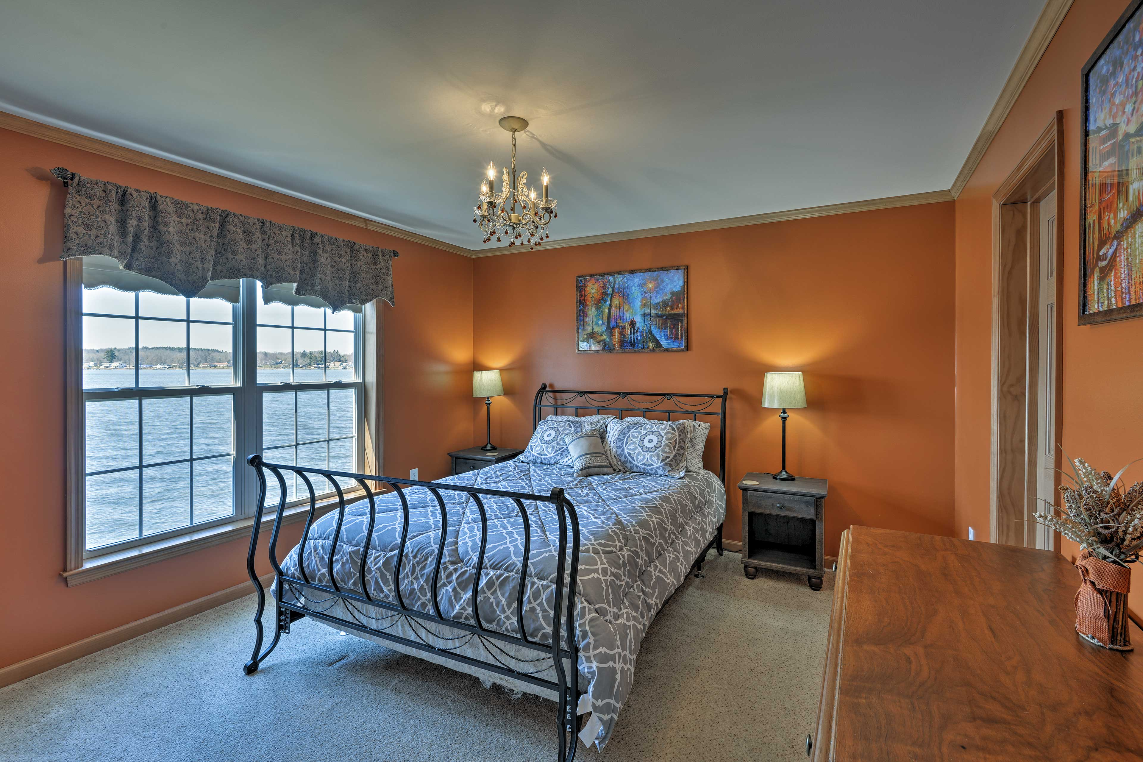 Rest your head on the queen bed in the first bedroom.