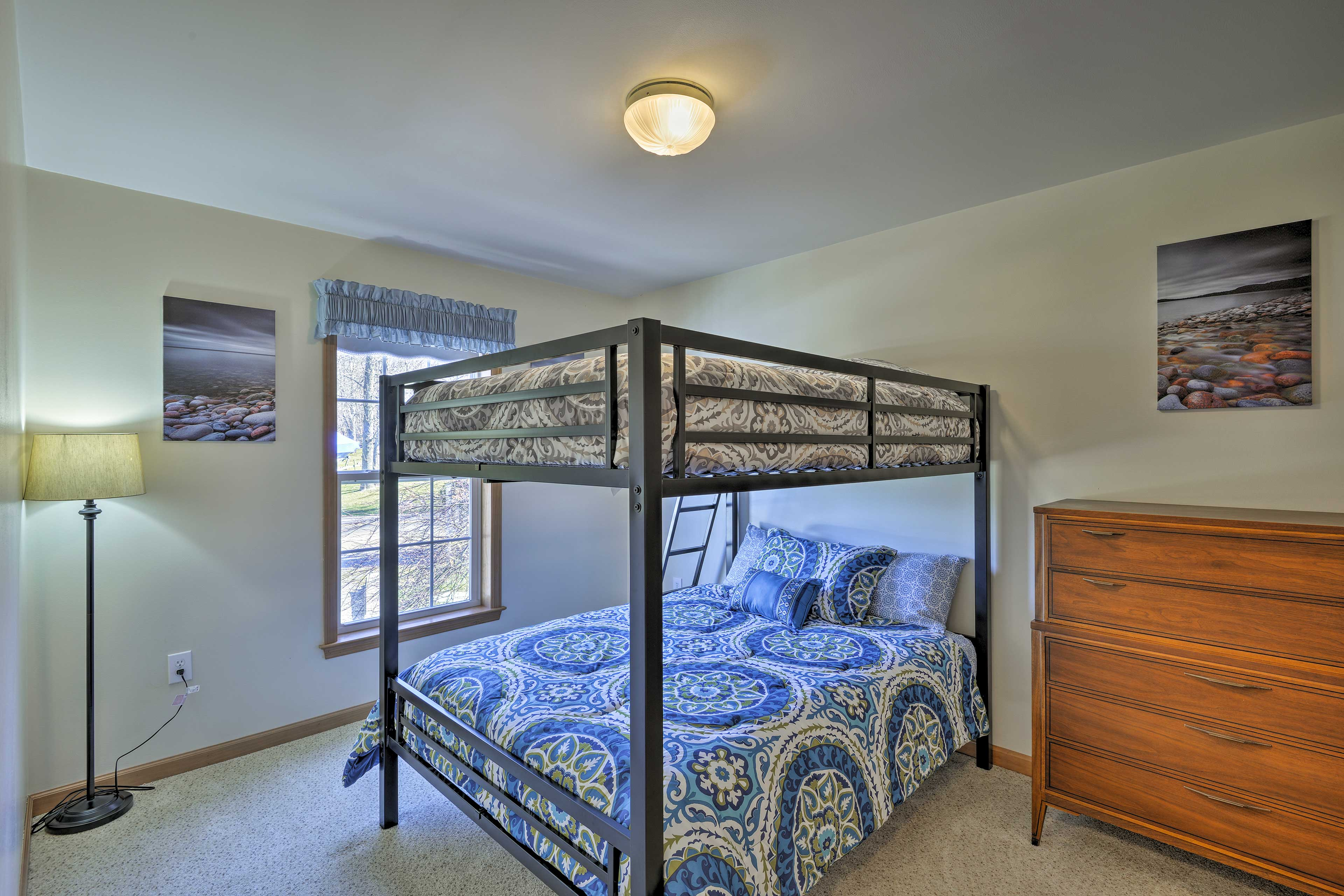 This bright room features a full-over-full bunk bed.