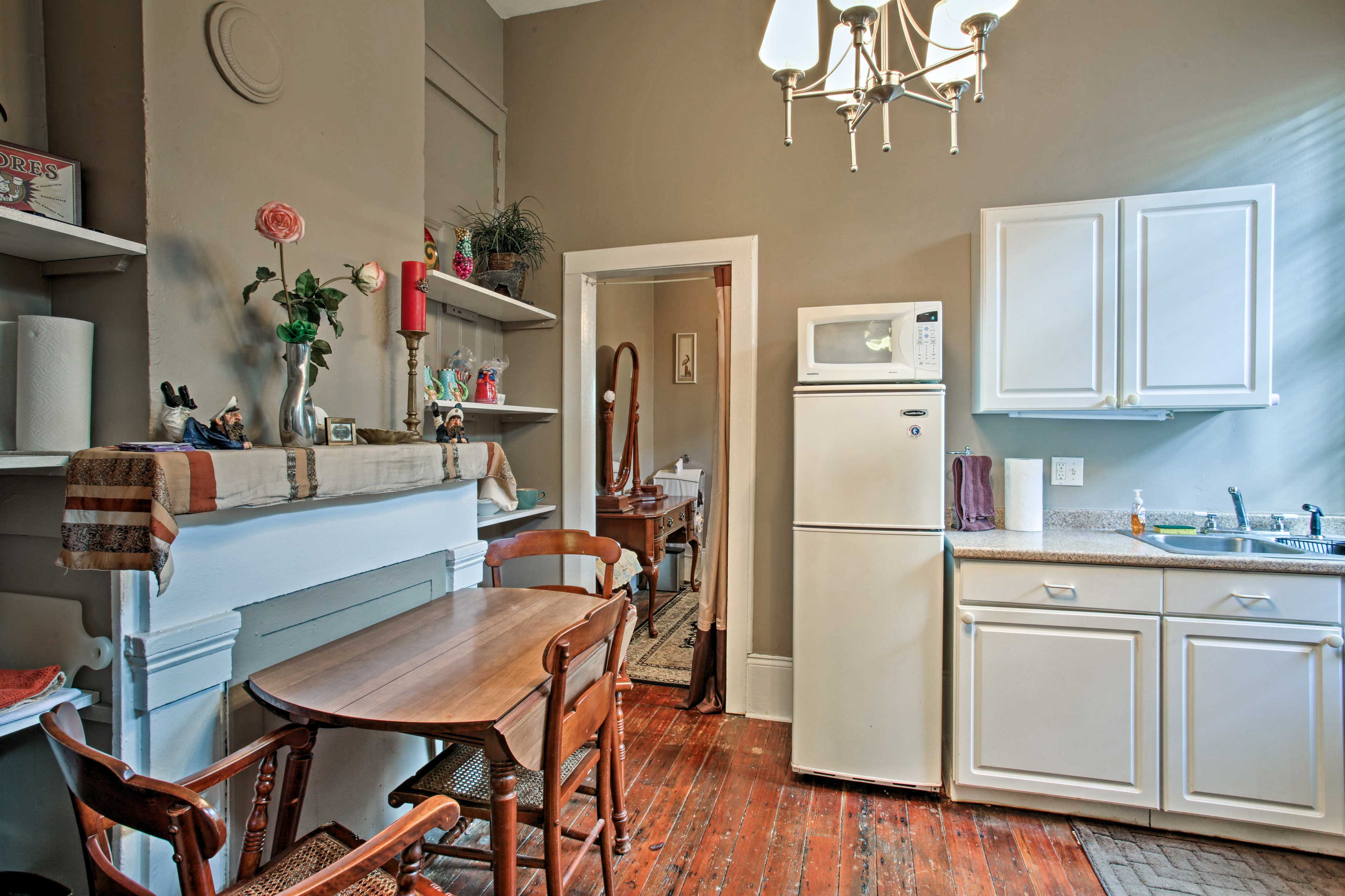A 2-person table sits right off the well-equipped kitchen.