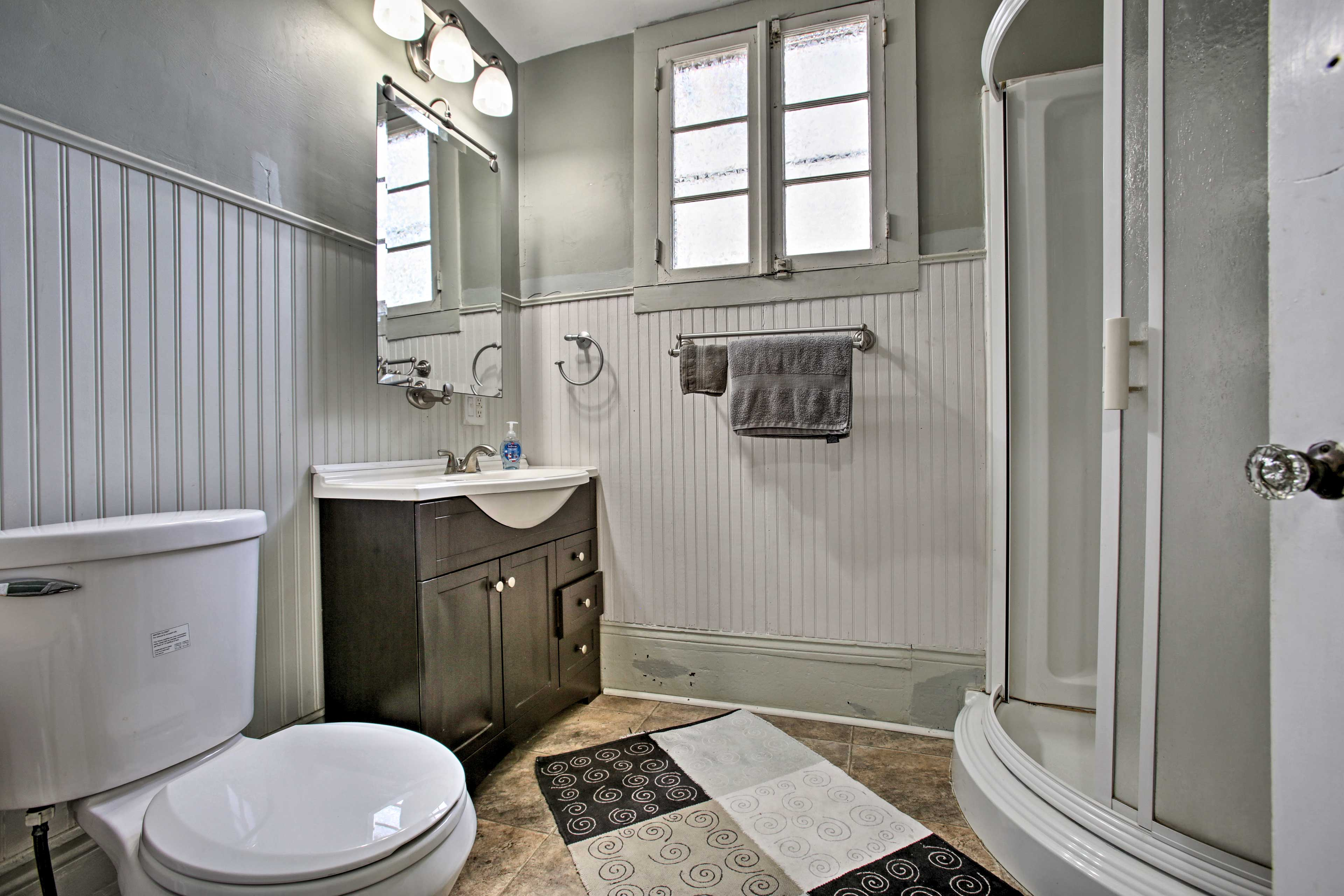 This bathroom boasts a spacious walk-in shower.