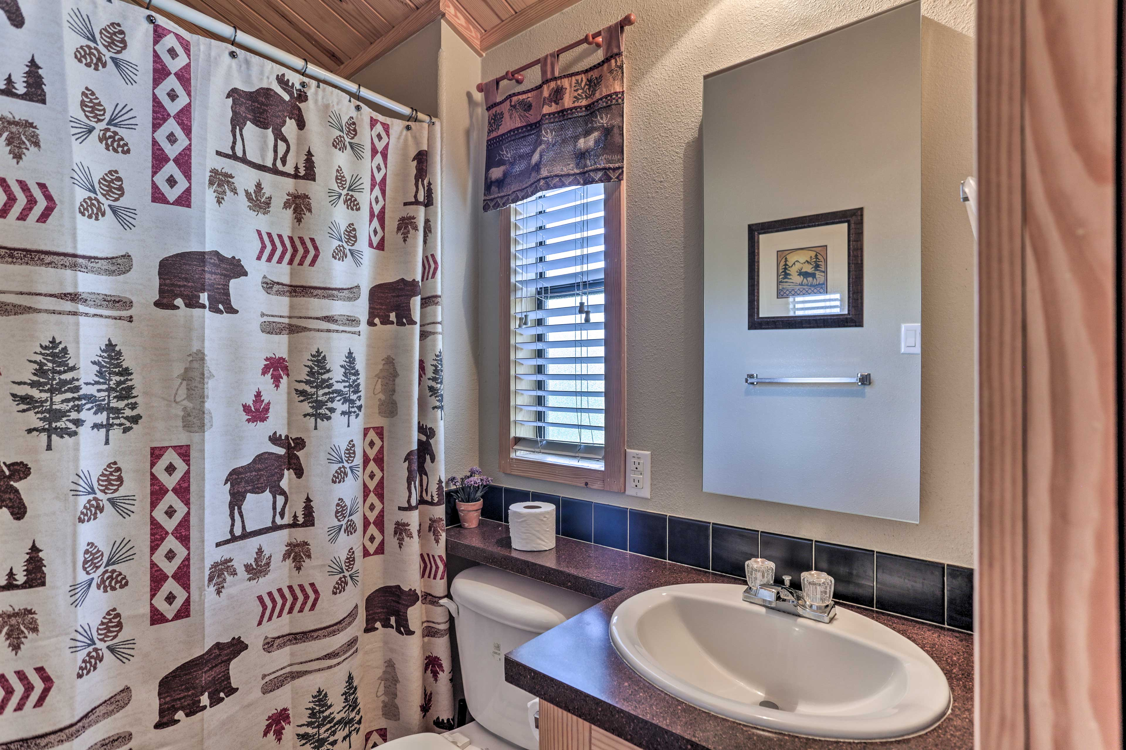 A shower/tub combo is provided in the full bathroom.
