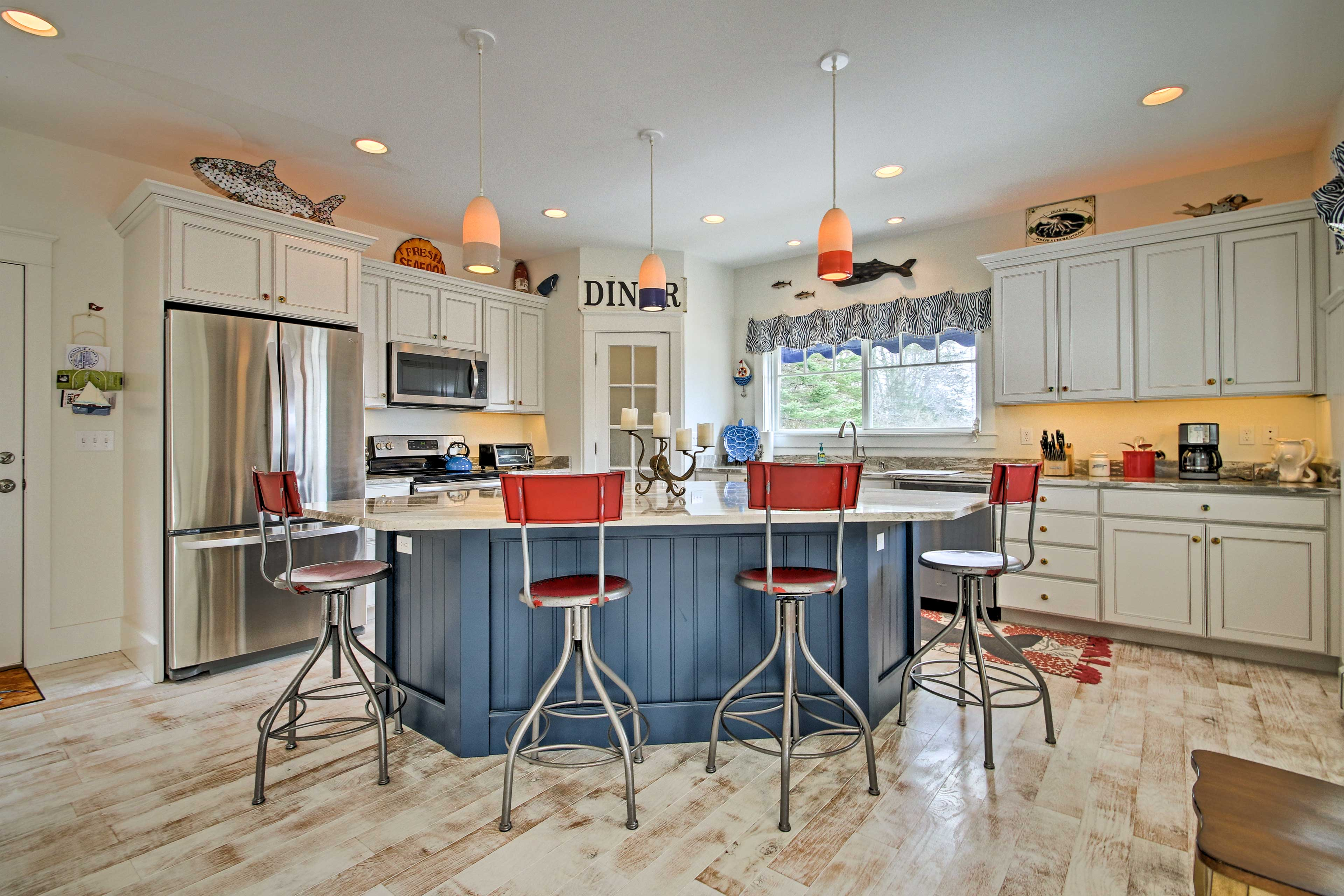 Prepare meals while guests watch at the breakfast bar.