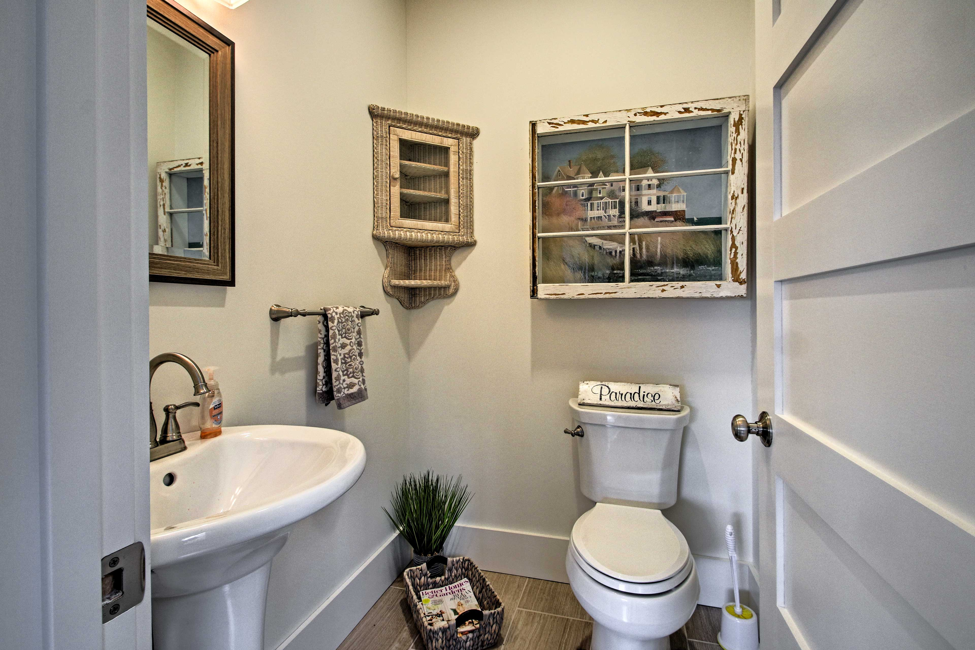 The half bathroom is located adjacent to the kitchen.