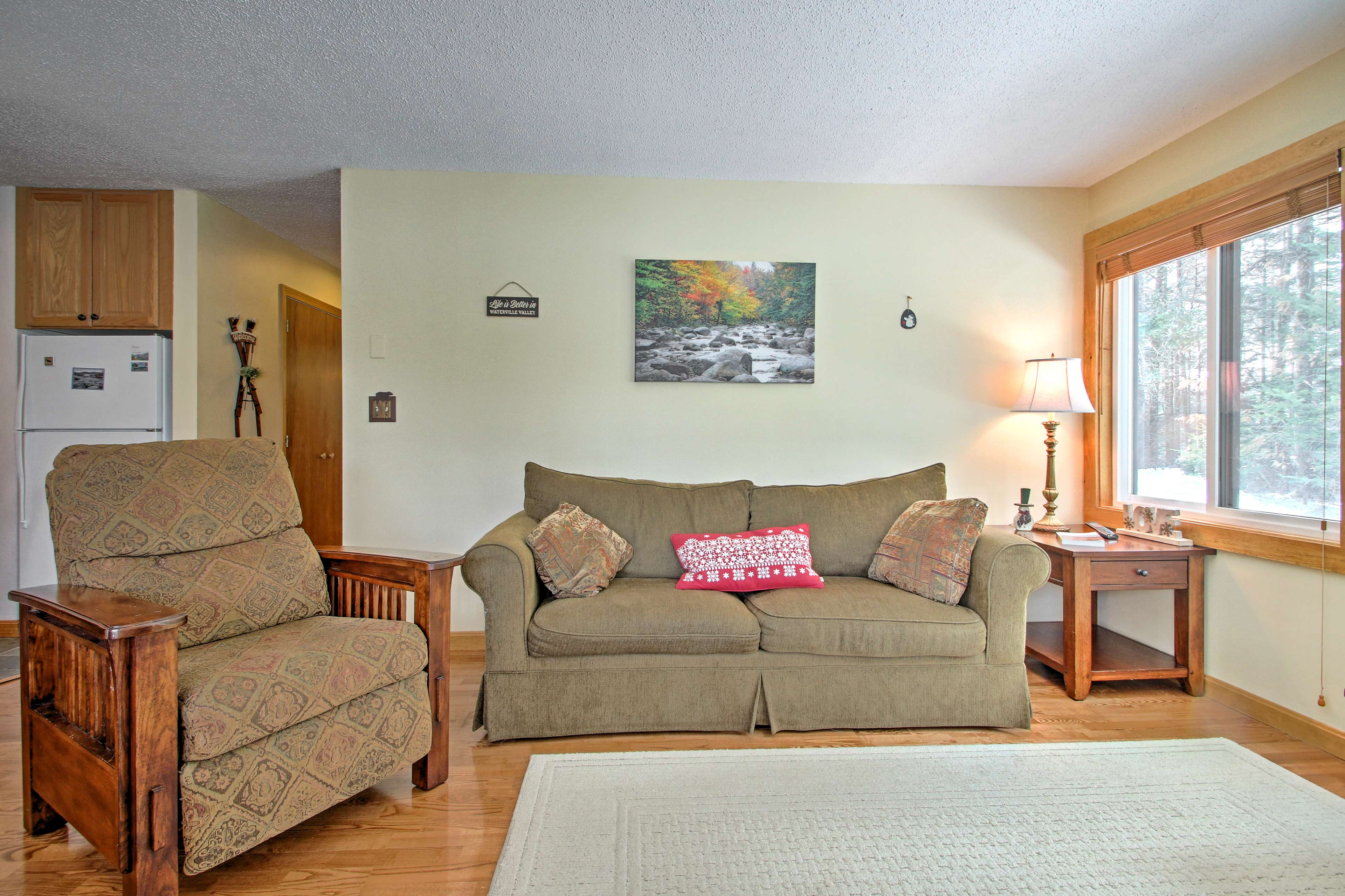 As you lounge on the plush couch you'll be bathed in natural light.