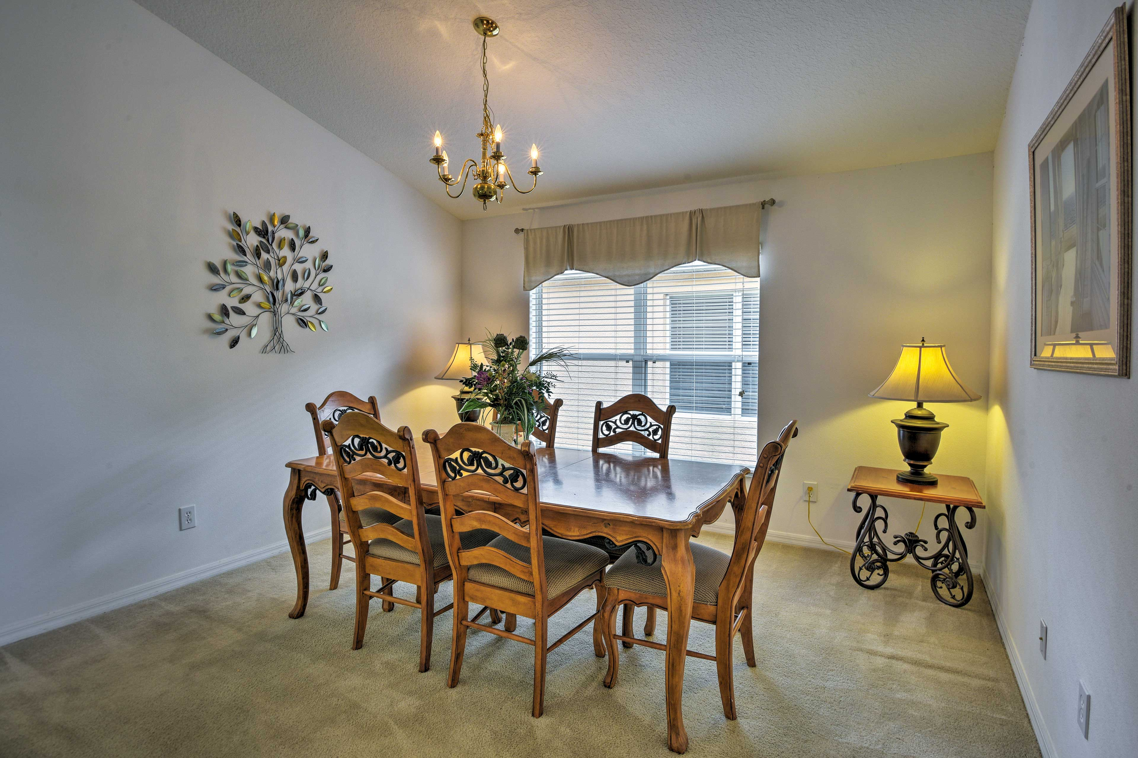 Gather around the dining room table to enjoy a home-cooked meal.