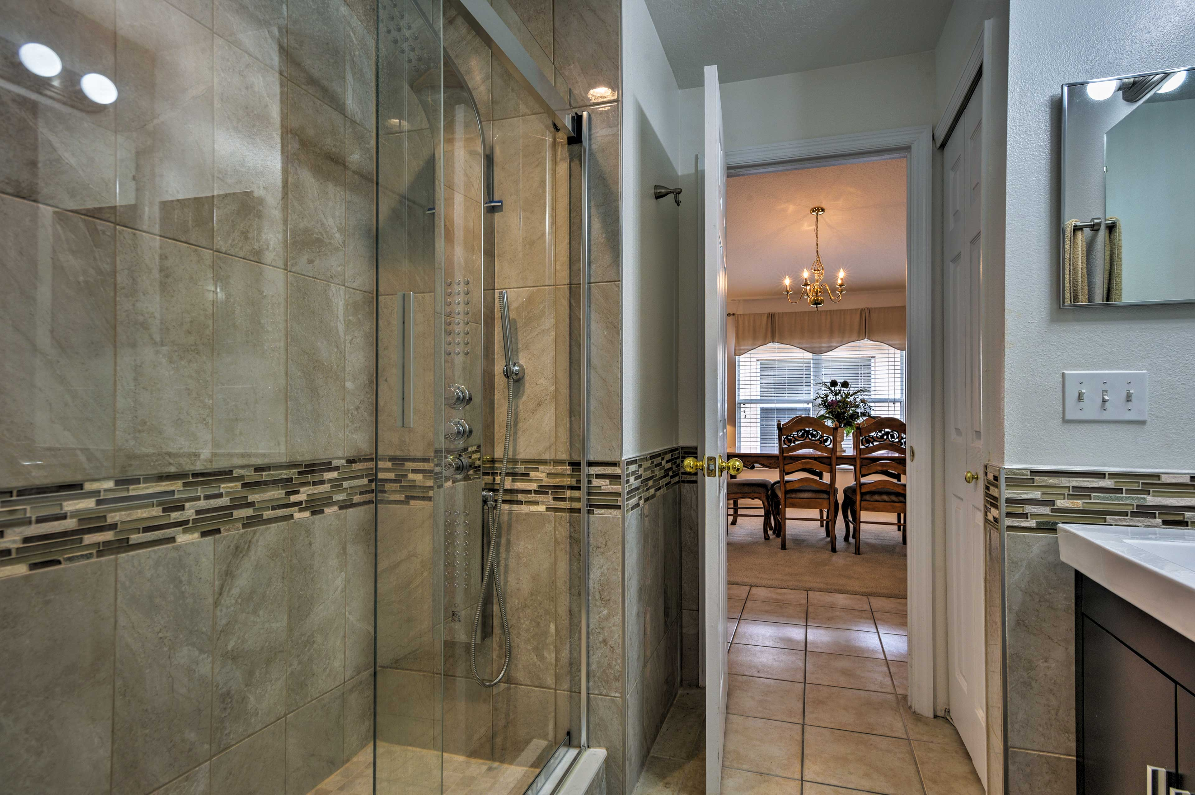 This walk-in shower offers a new showerhead for a refreshing rinse.