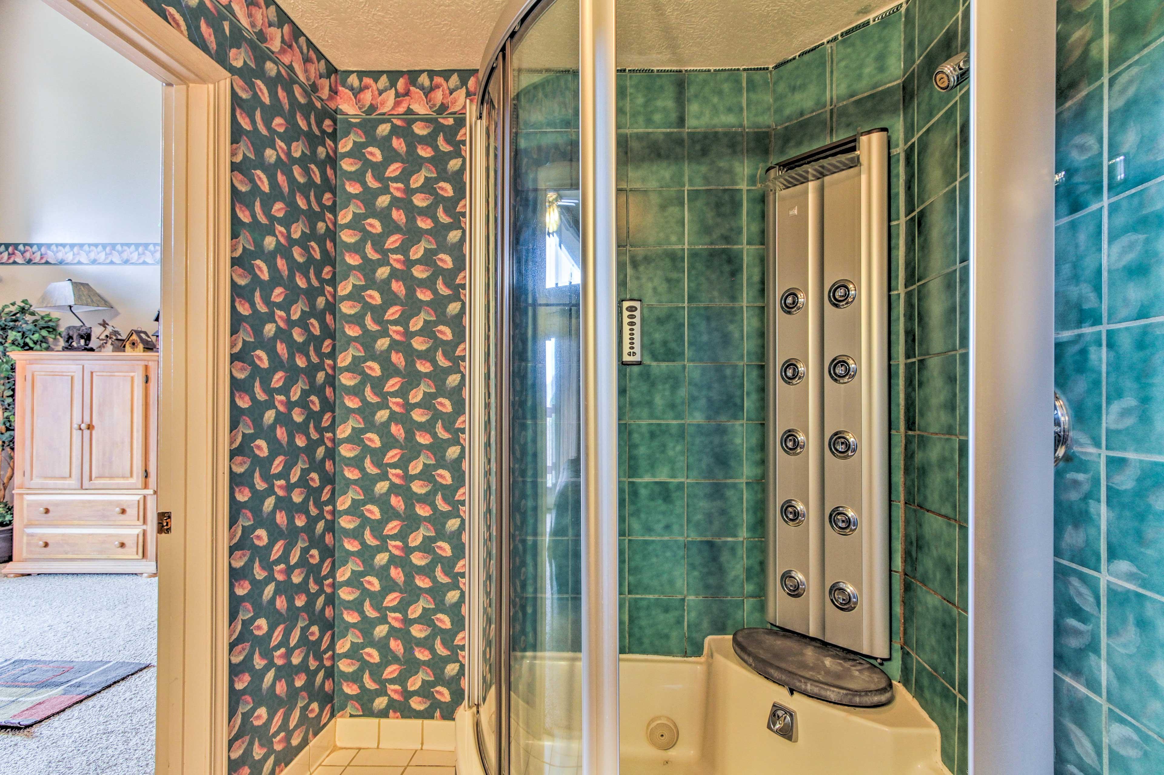 Enjoying a relaxing soak in the full-body walk-in shower.