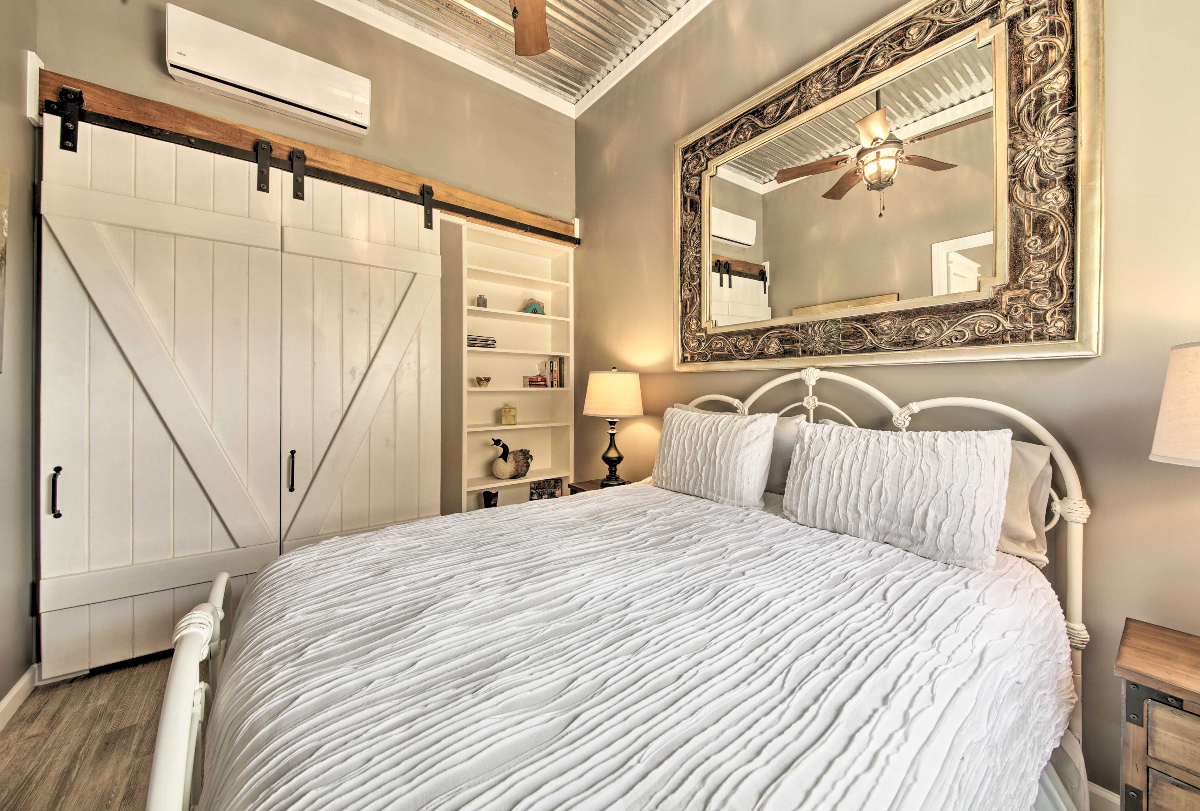 This first bedroom houses a queen-sized bed.