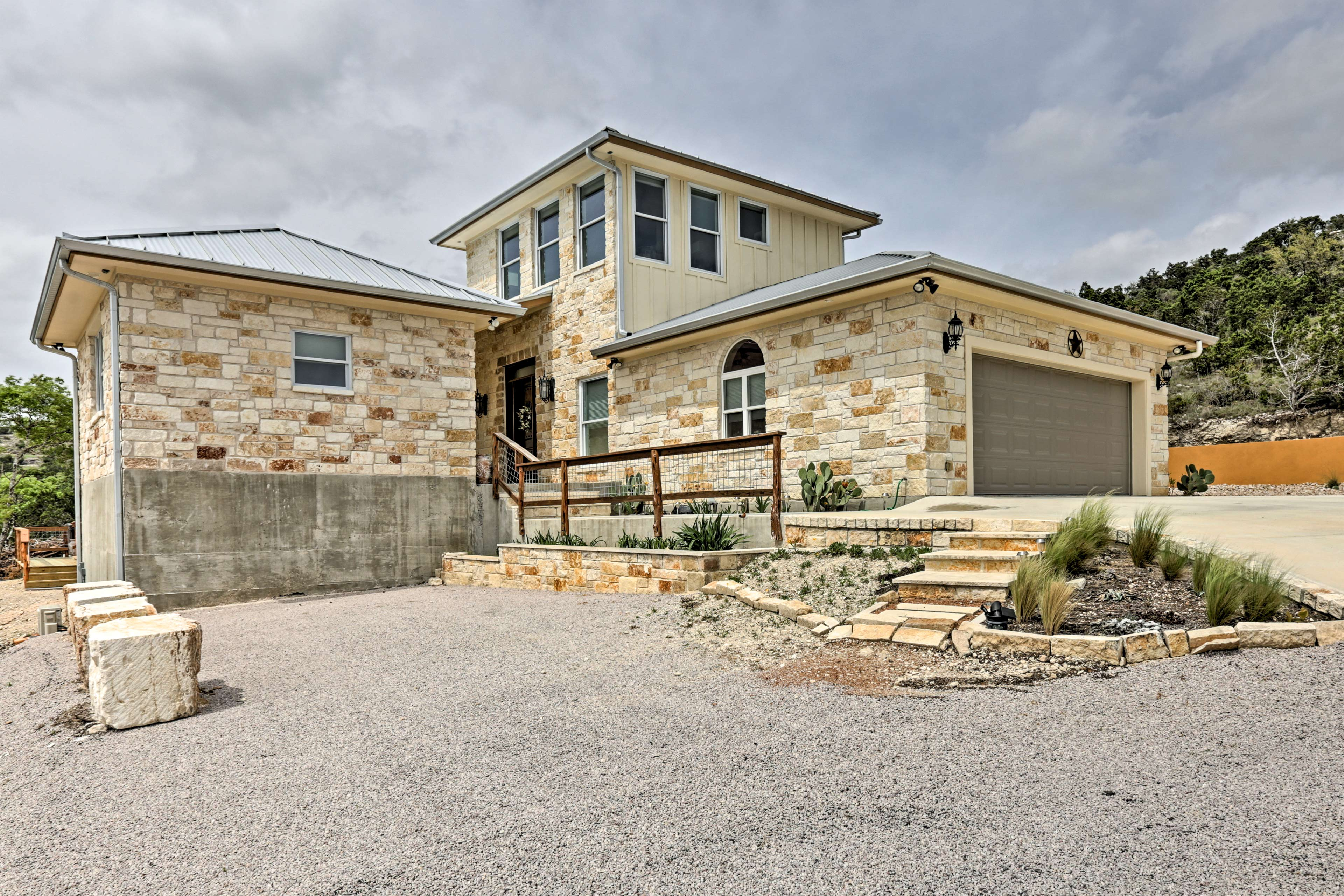 Traditional Texas limestone lines the exterior.