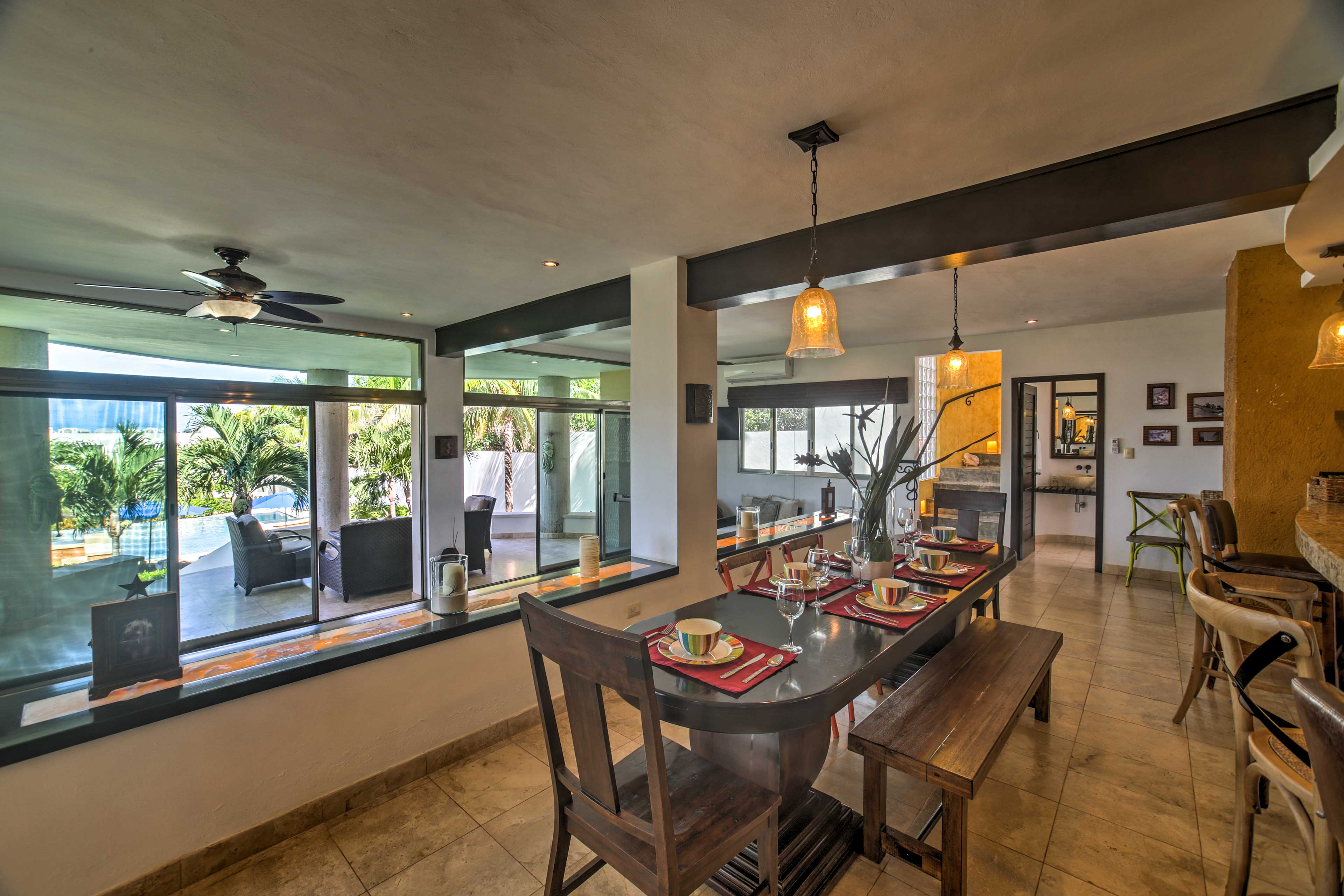 Pull up a chair to enjoy a meal together in the main villa.