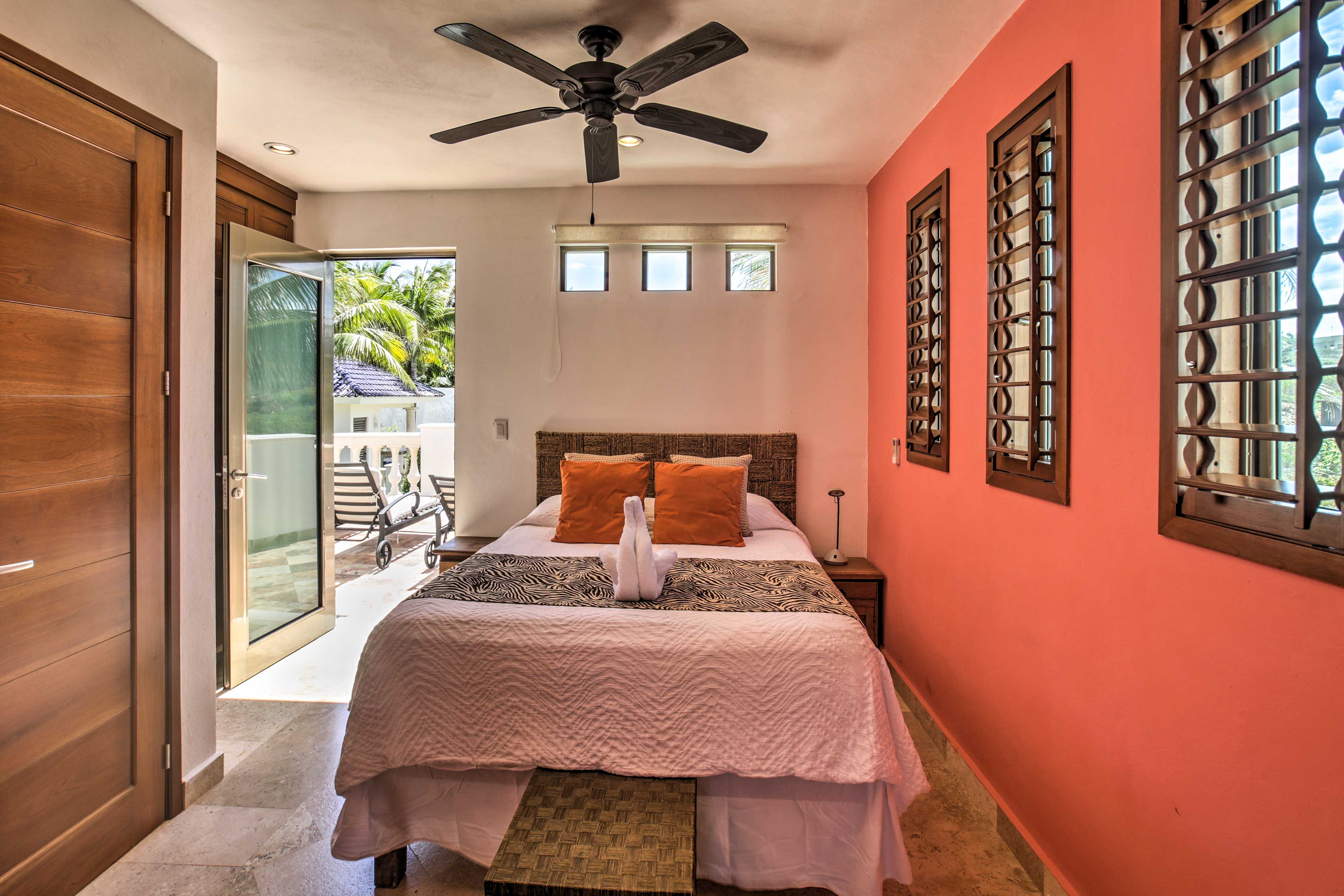 This bedroom has direct access to the pool.
