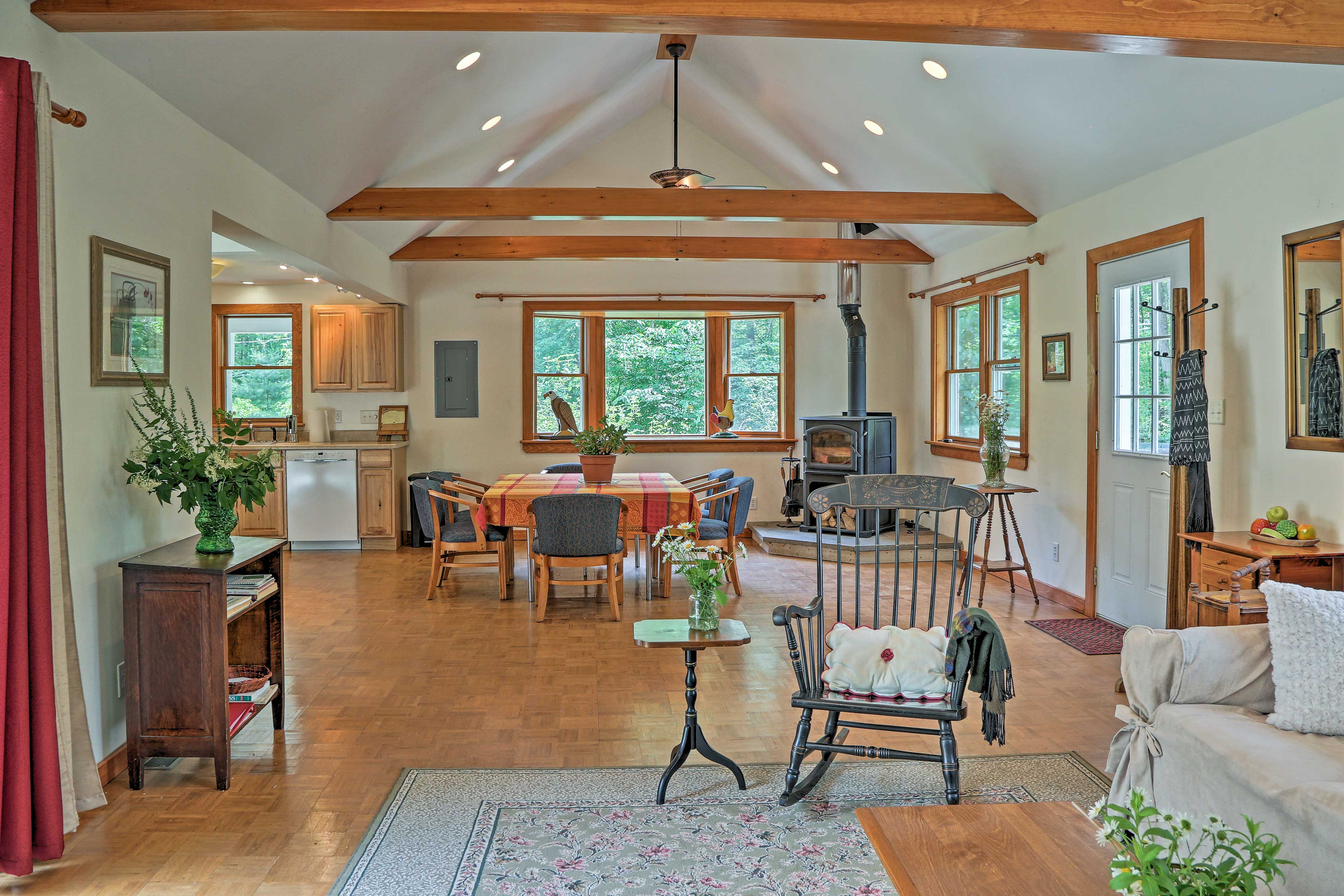 Exposed beams and vaulted ceilings create a spacious interior.