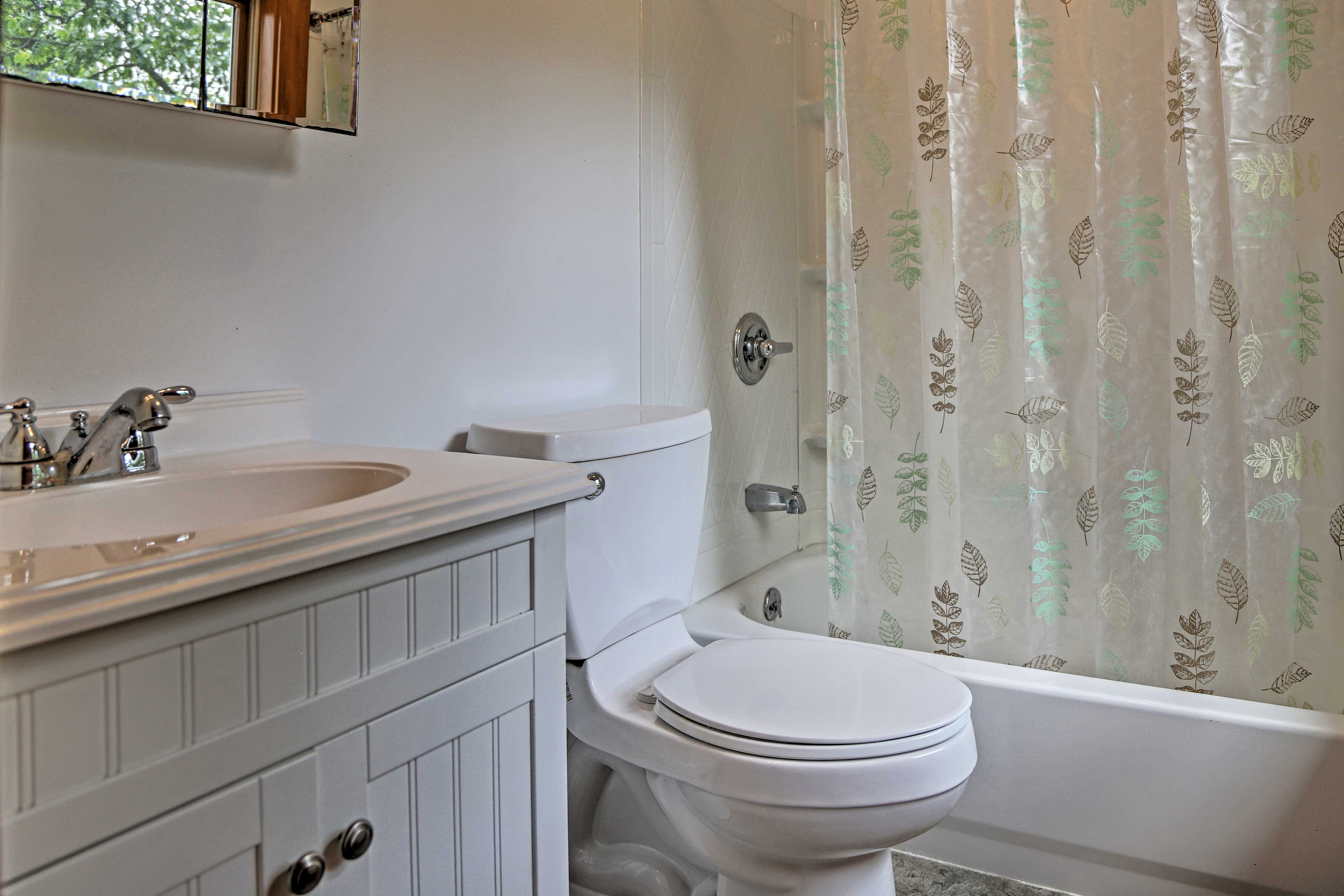 Your en-suite bathroom includes a shower/tub combo.