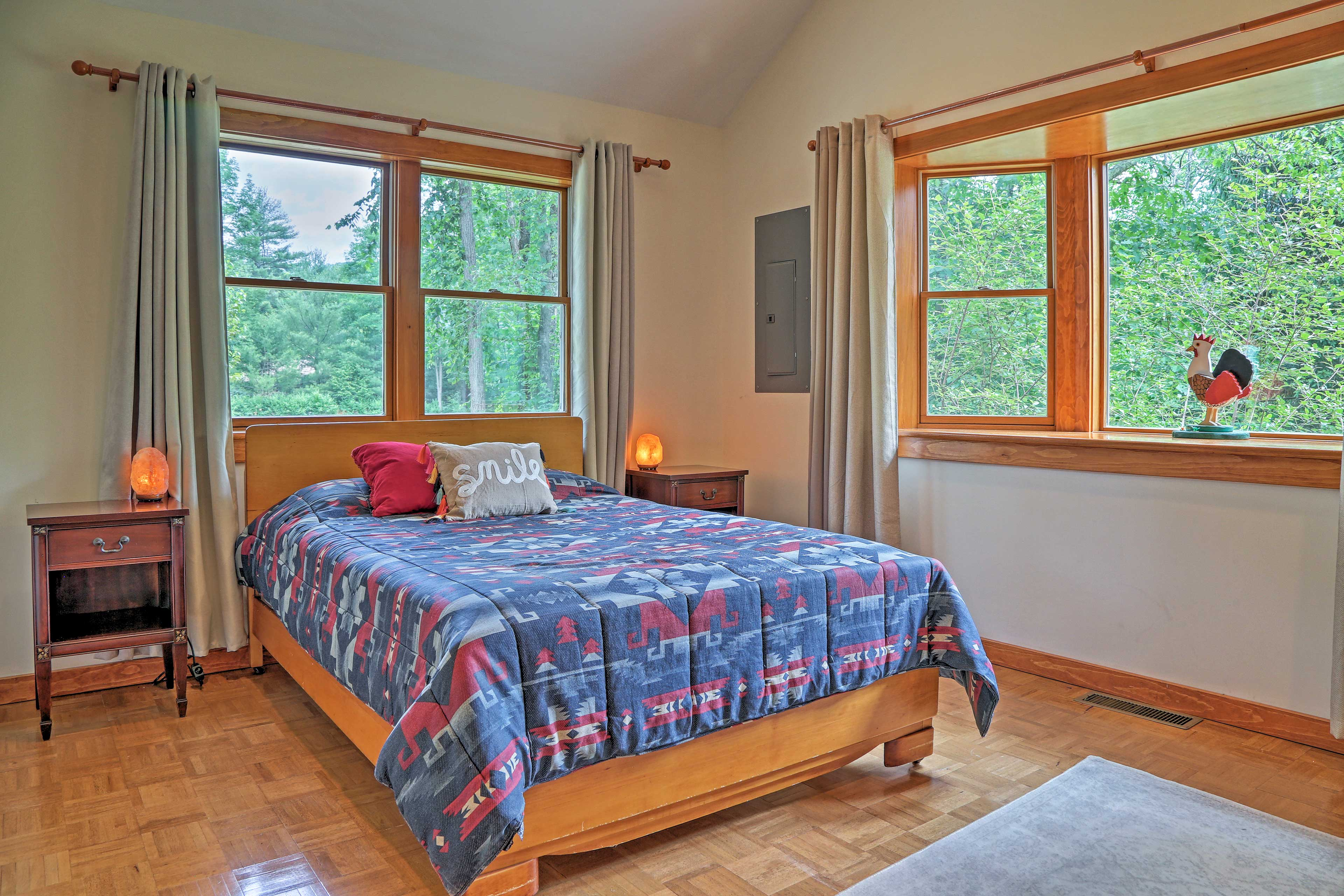 The second bedroom houses a cozy queen bed.