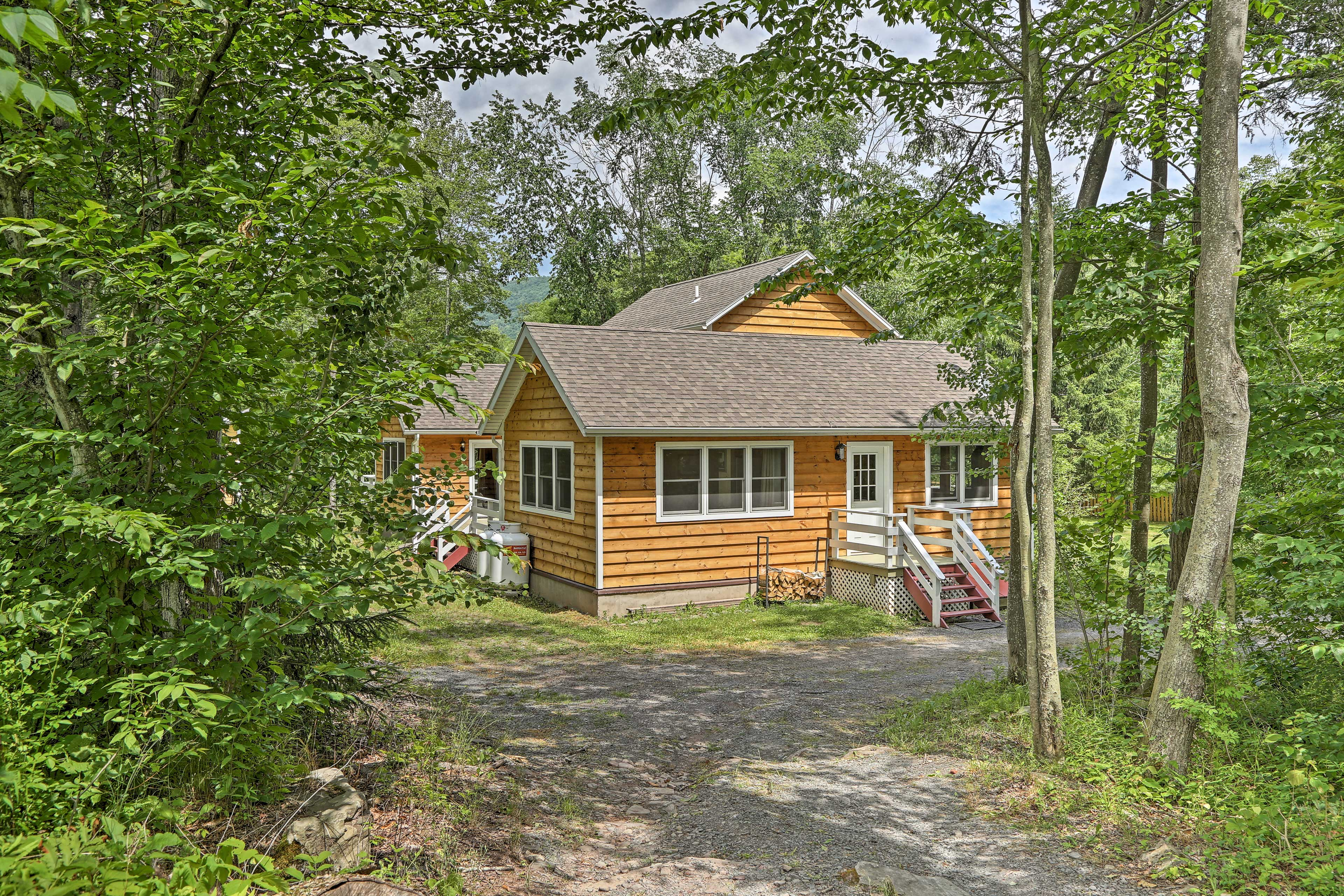 Discover this home nestled amid the woods.
