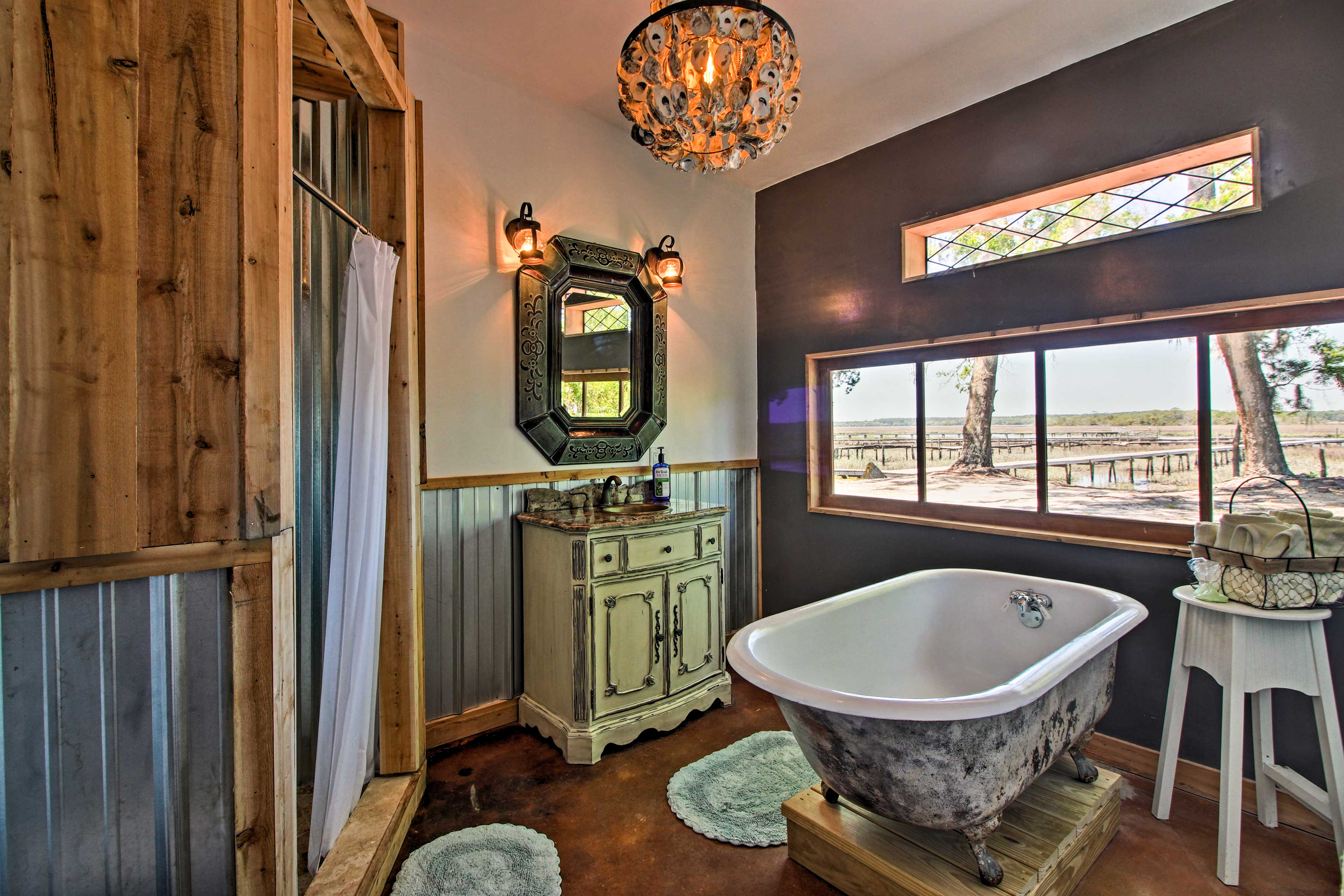 Soak in the claw foot tub as you enjoy the waterfront view!