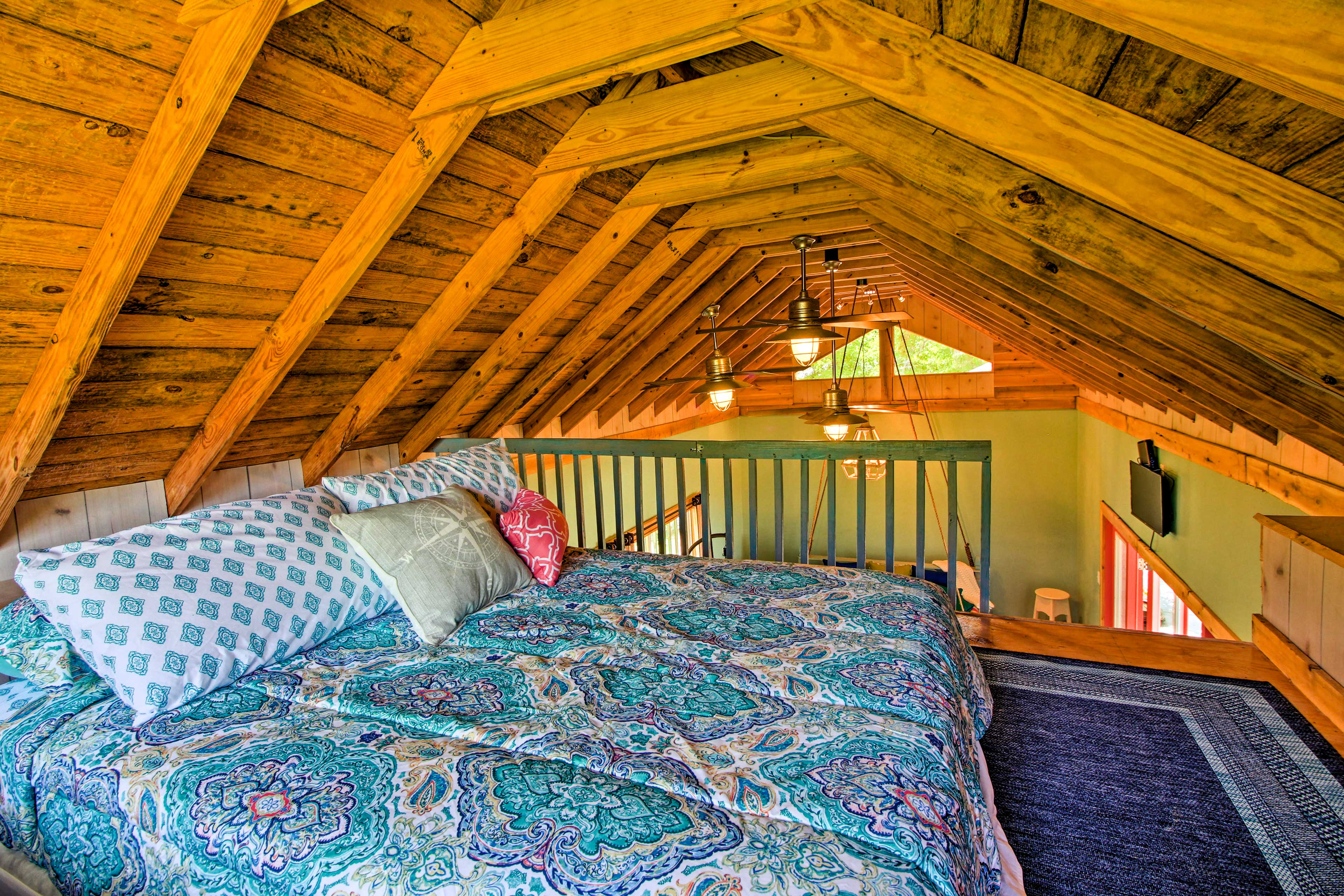 Climb the ladder to the loft which features a full size bed!
