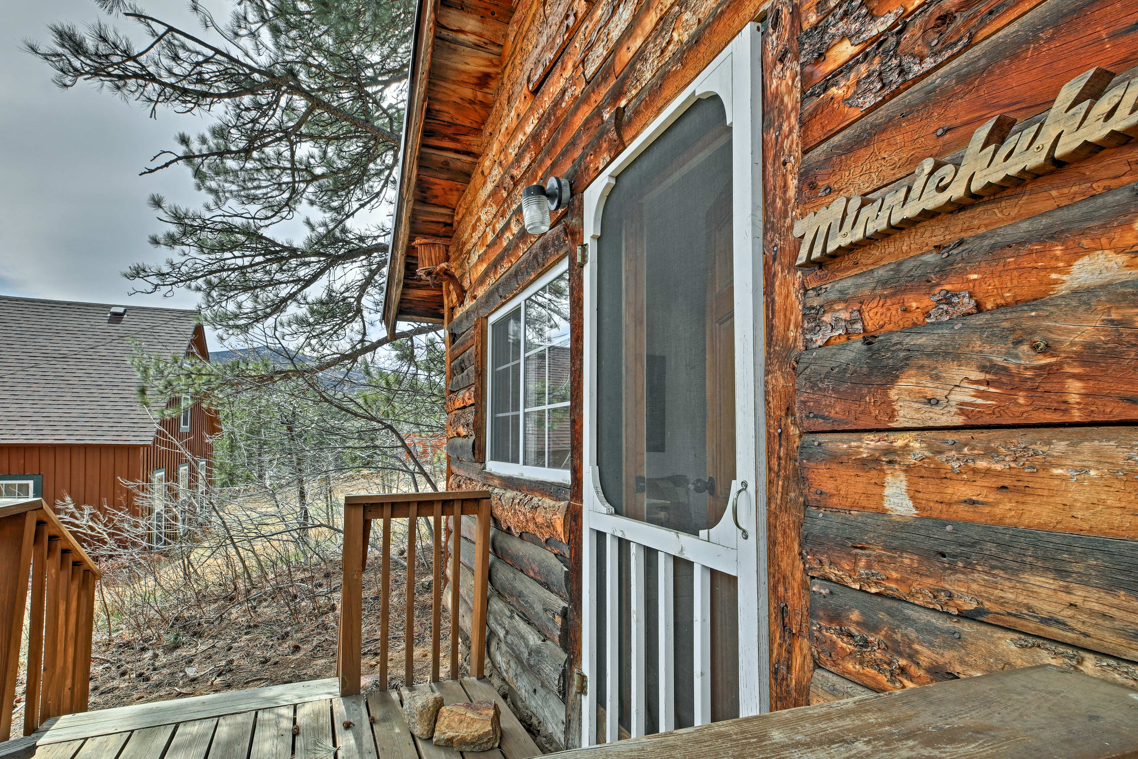 The classic cabin is located in the small town of Allenspark.