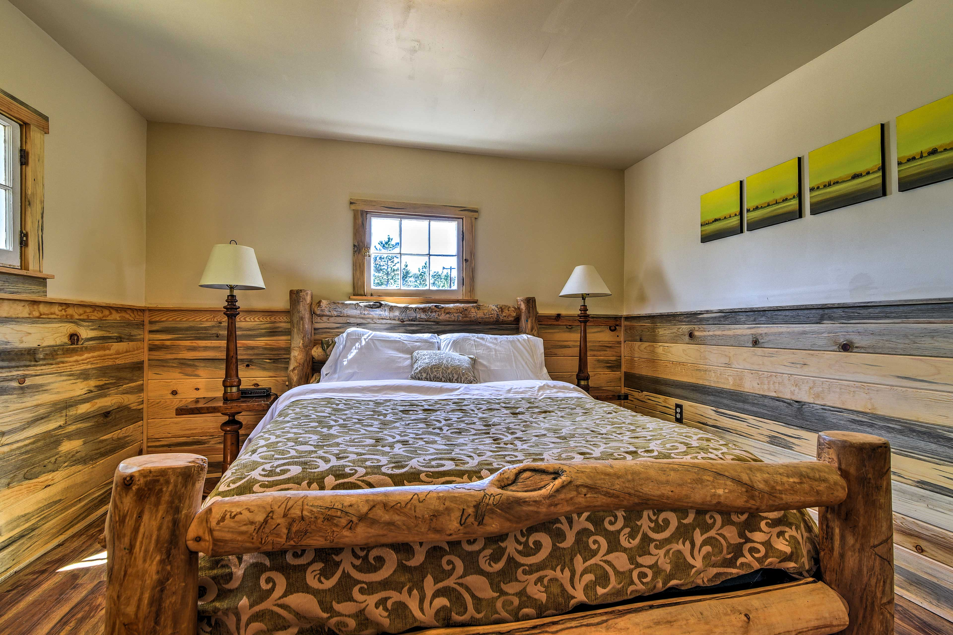 The bedroom includes a queen-sized bed.