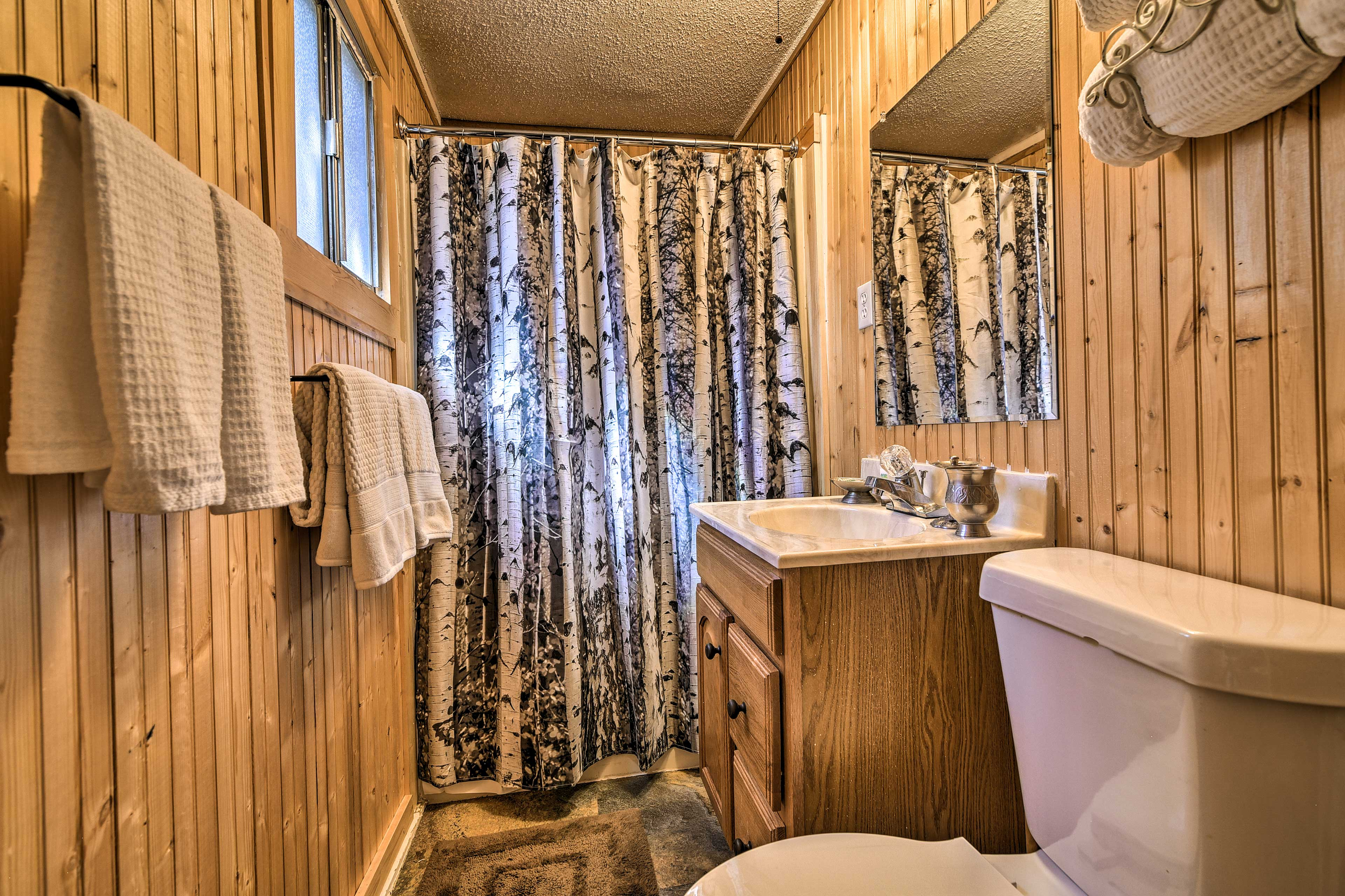 The Aspen tree shower curtain matches outside perfectly!