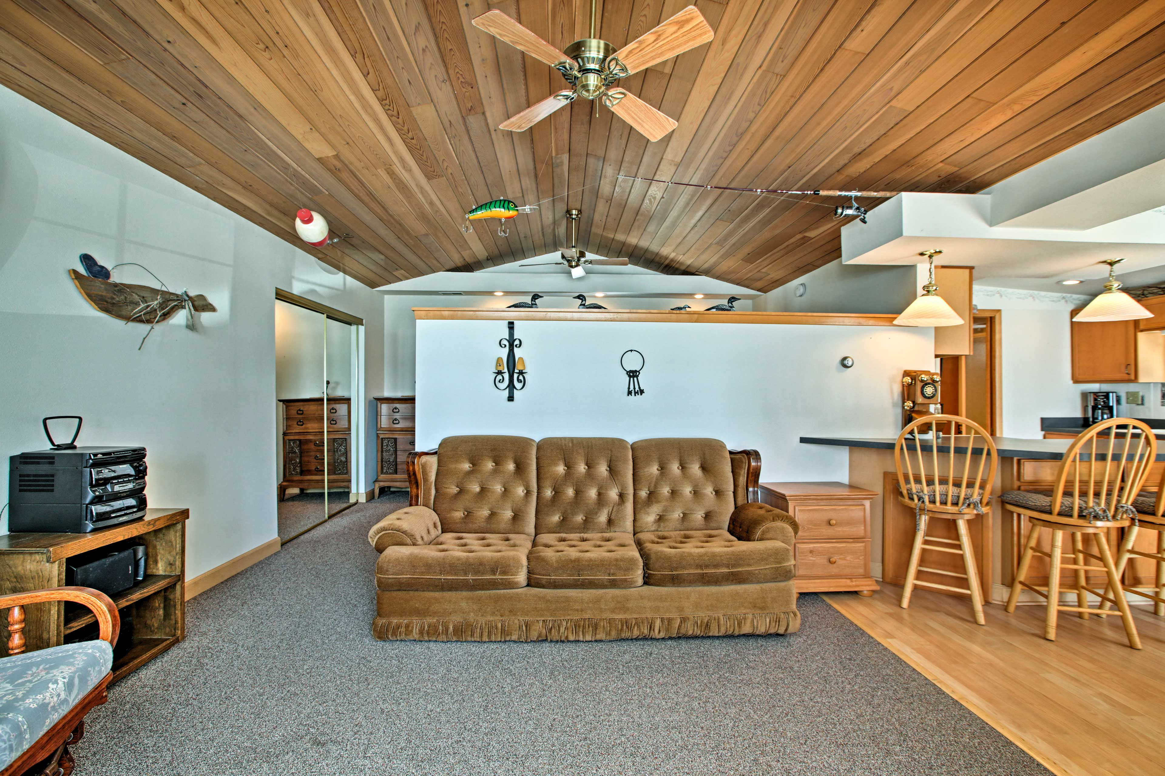 Relax on the comfortable 3-person sofa in the living room.