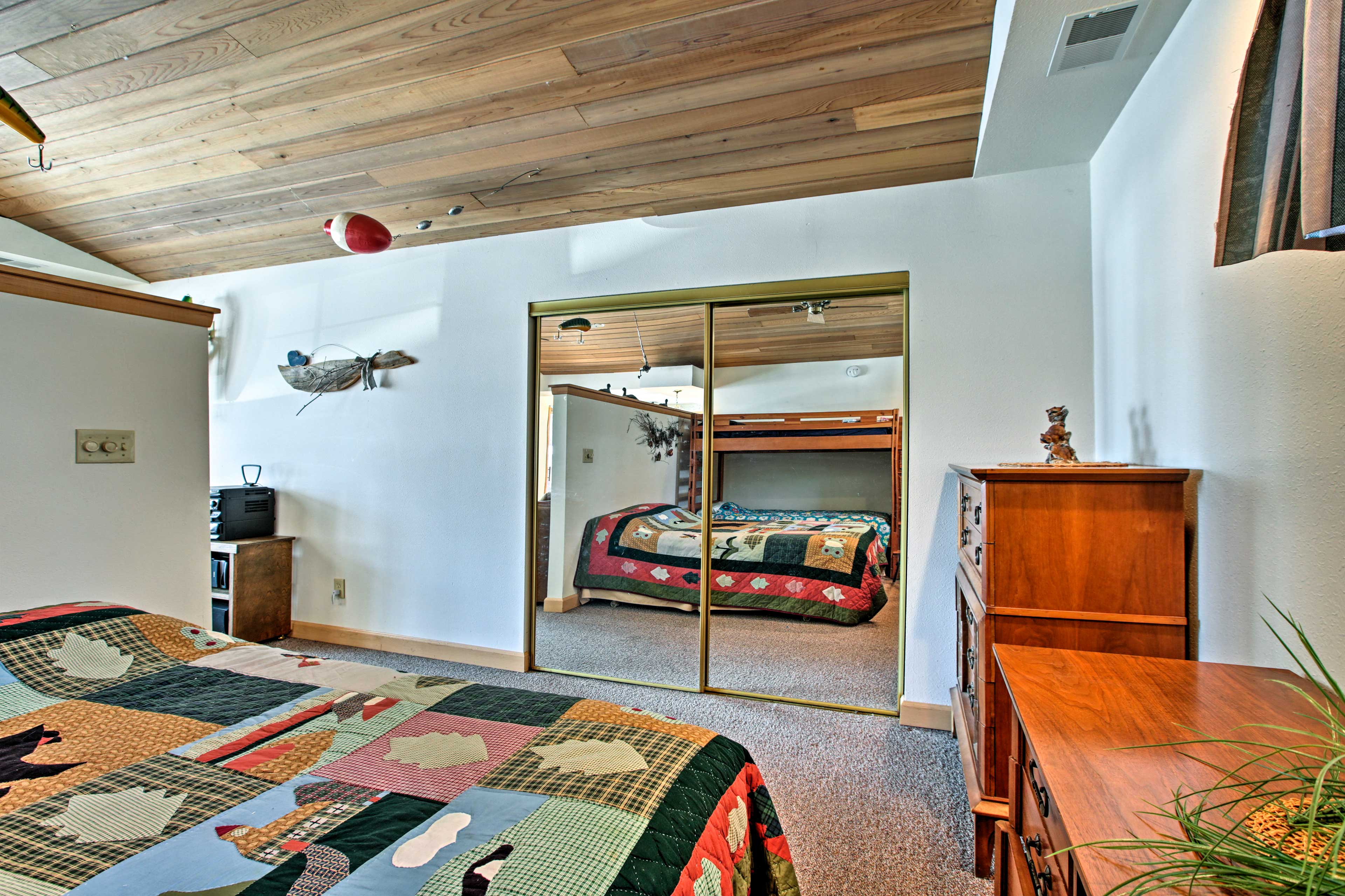 The bedroom has a queen bed and a twin-over-twin bunk bed.
