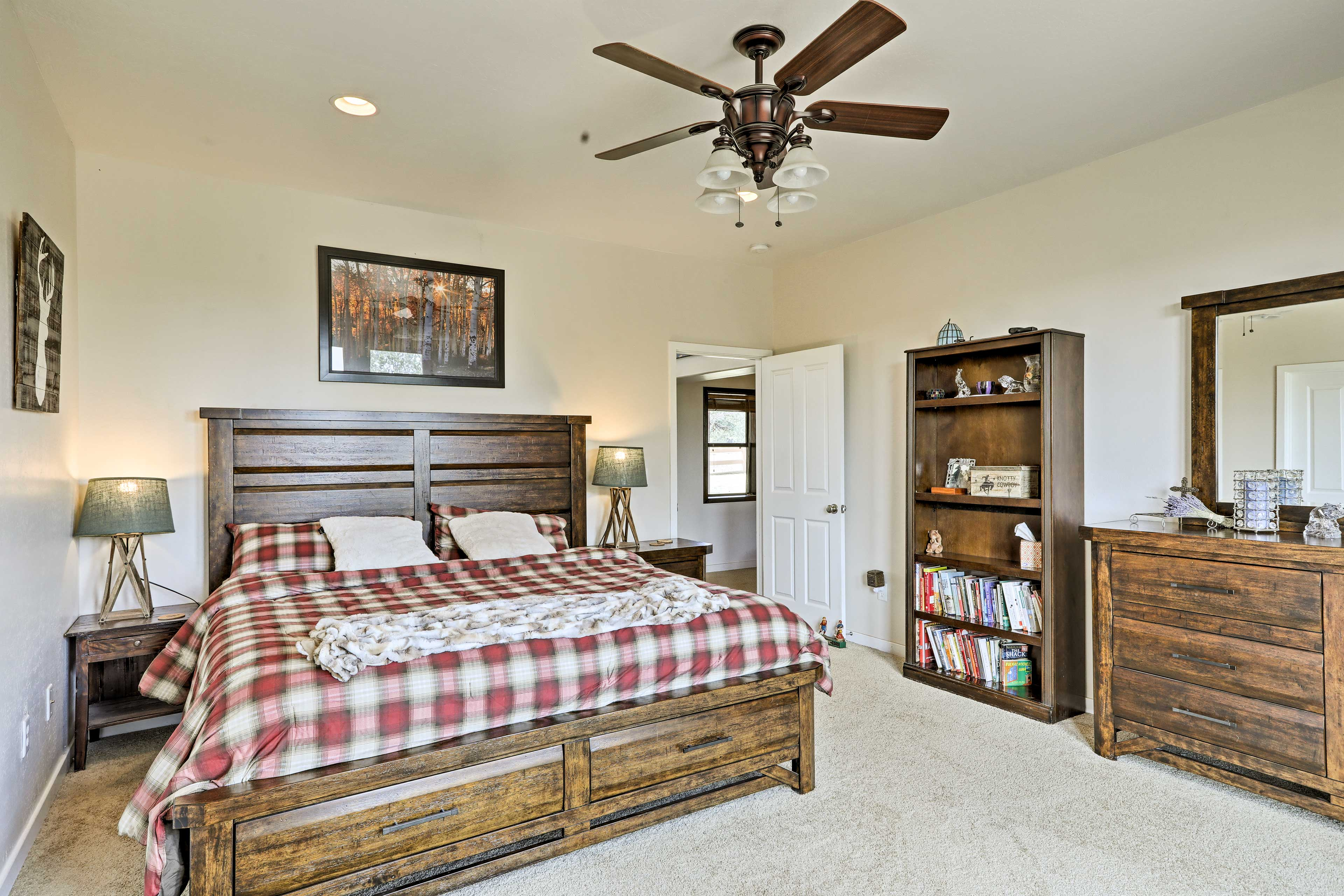 The master bedroom has a cozy king mattress.