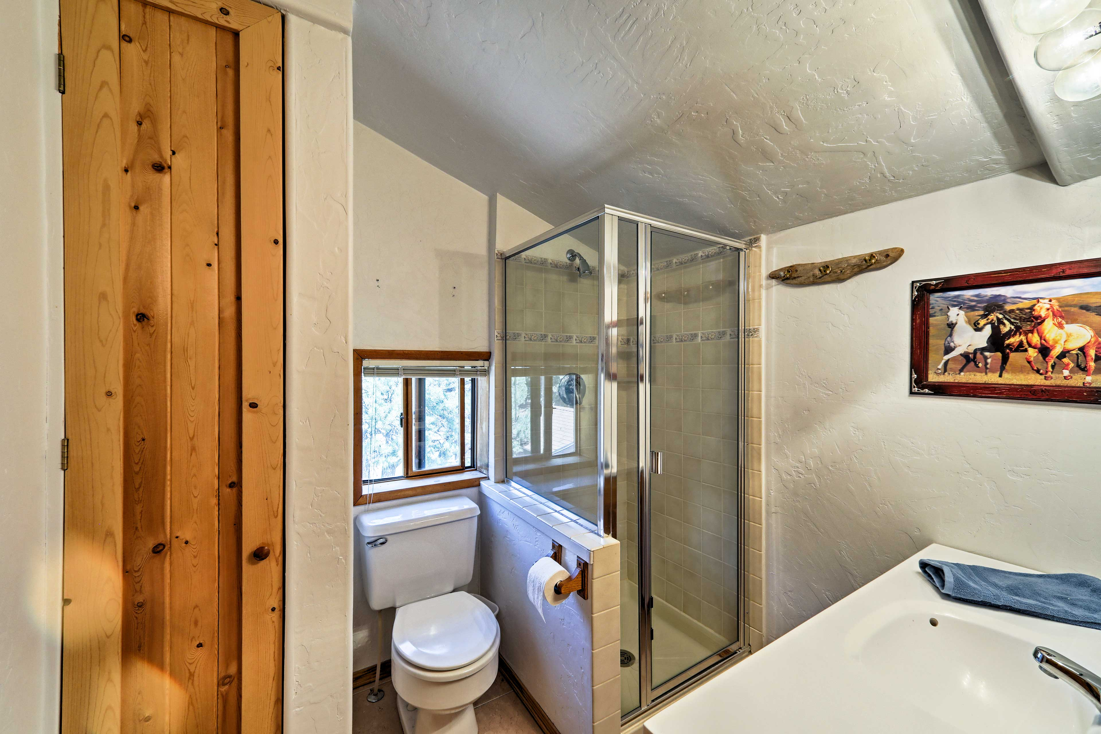 The third and final bathroom has a stand-up shower for extra space to rinse off!