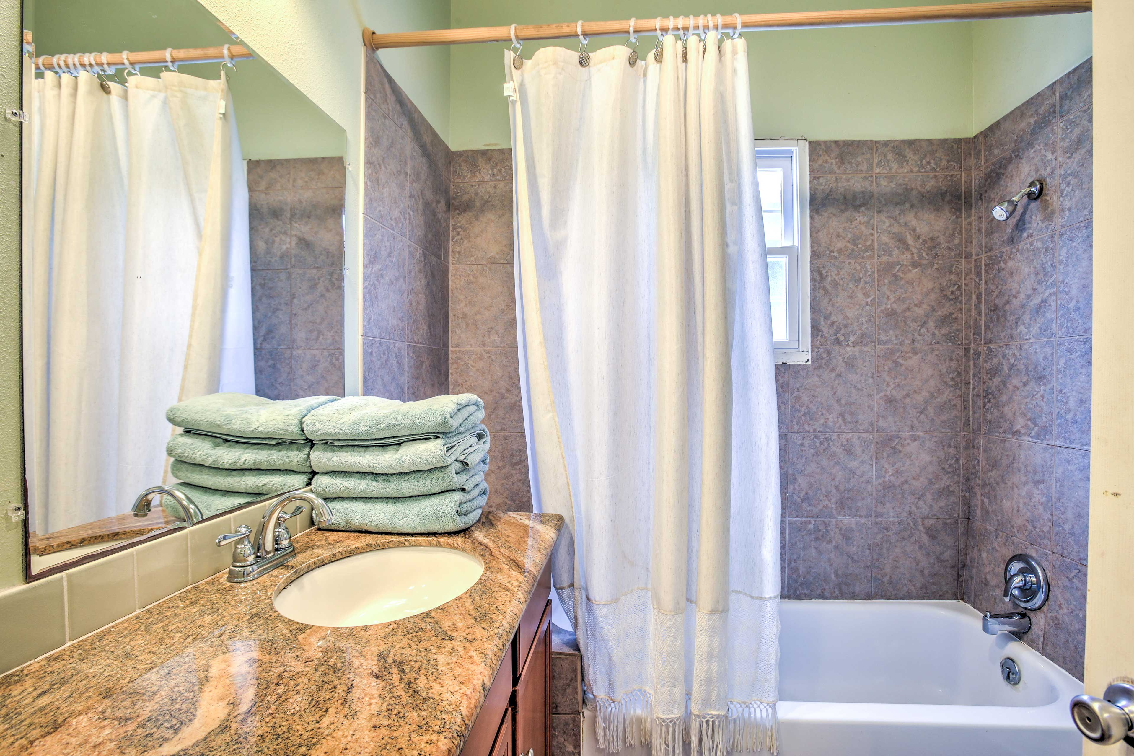 Treat yourself to a rejuvenating shower in the upgraded bathroom.