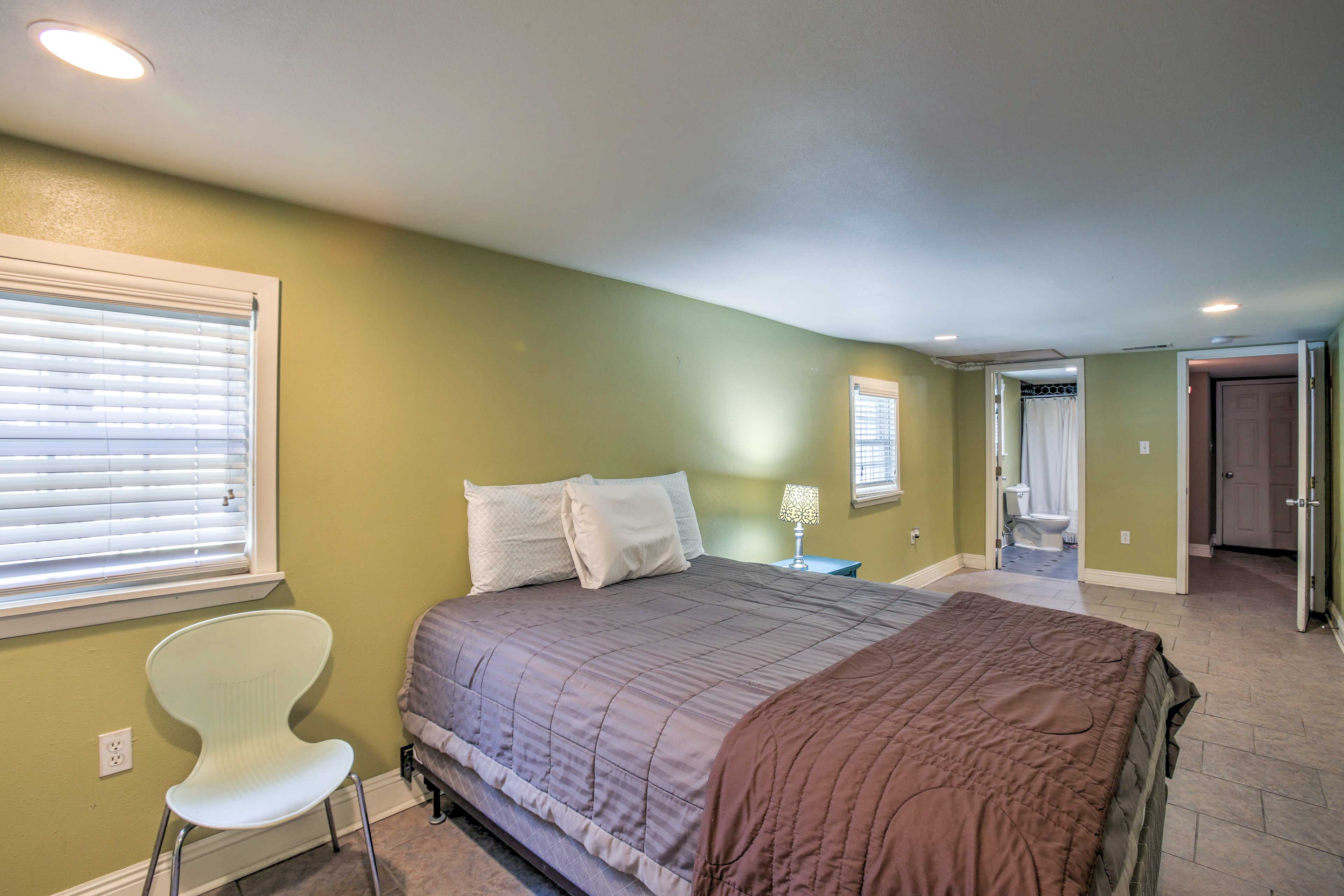 Downstairs, the master bedroom has a queen bed and an en-suite bathroom.