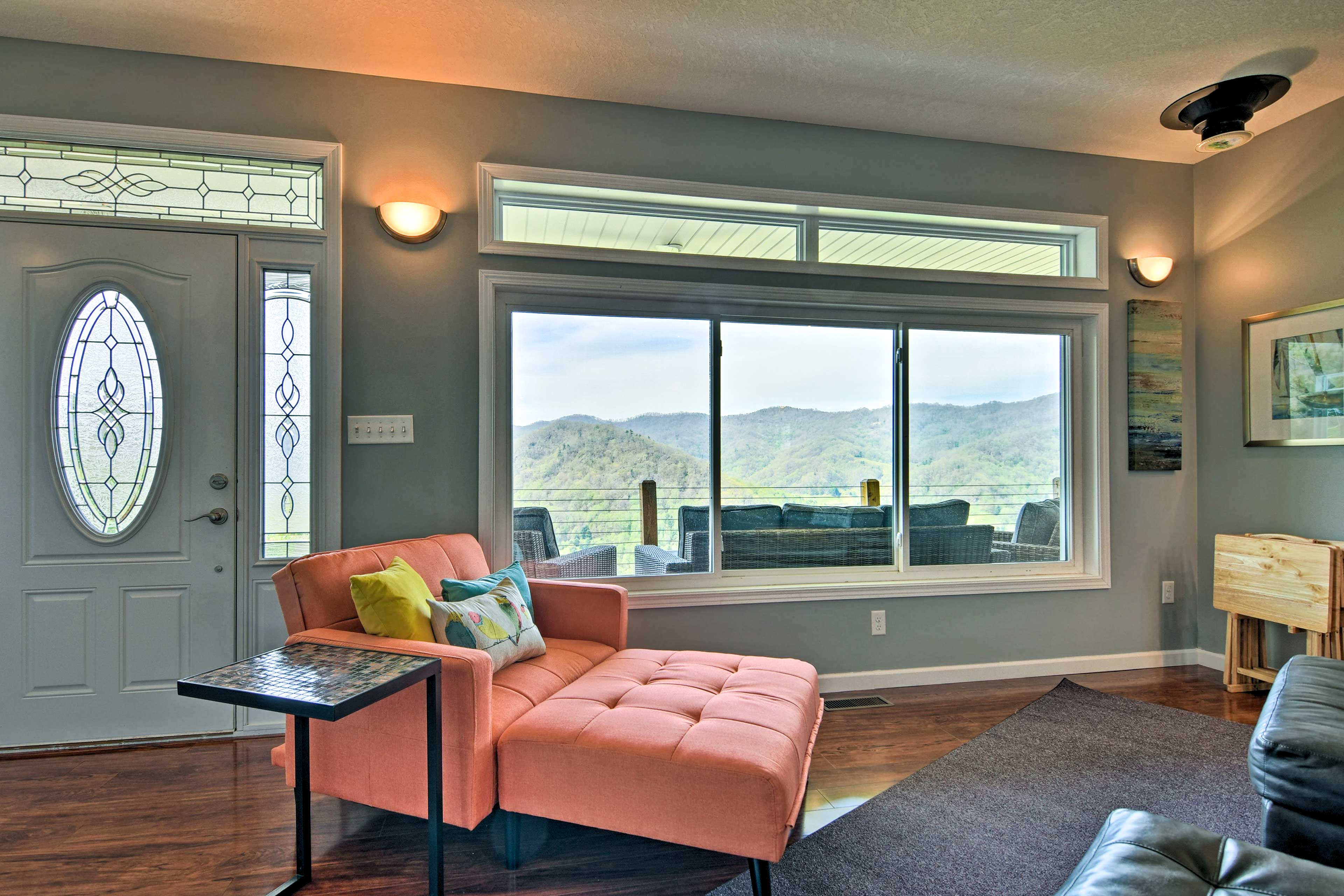 A full wall of picture windows brings the surrounding scenery indoors.