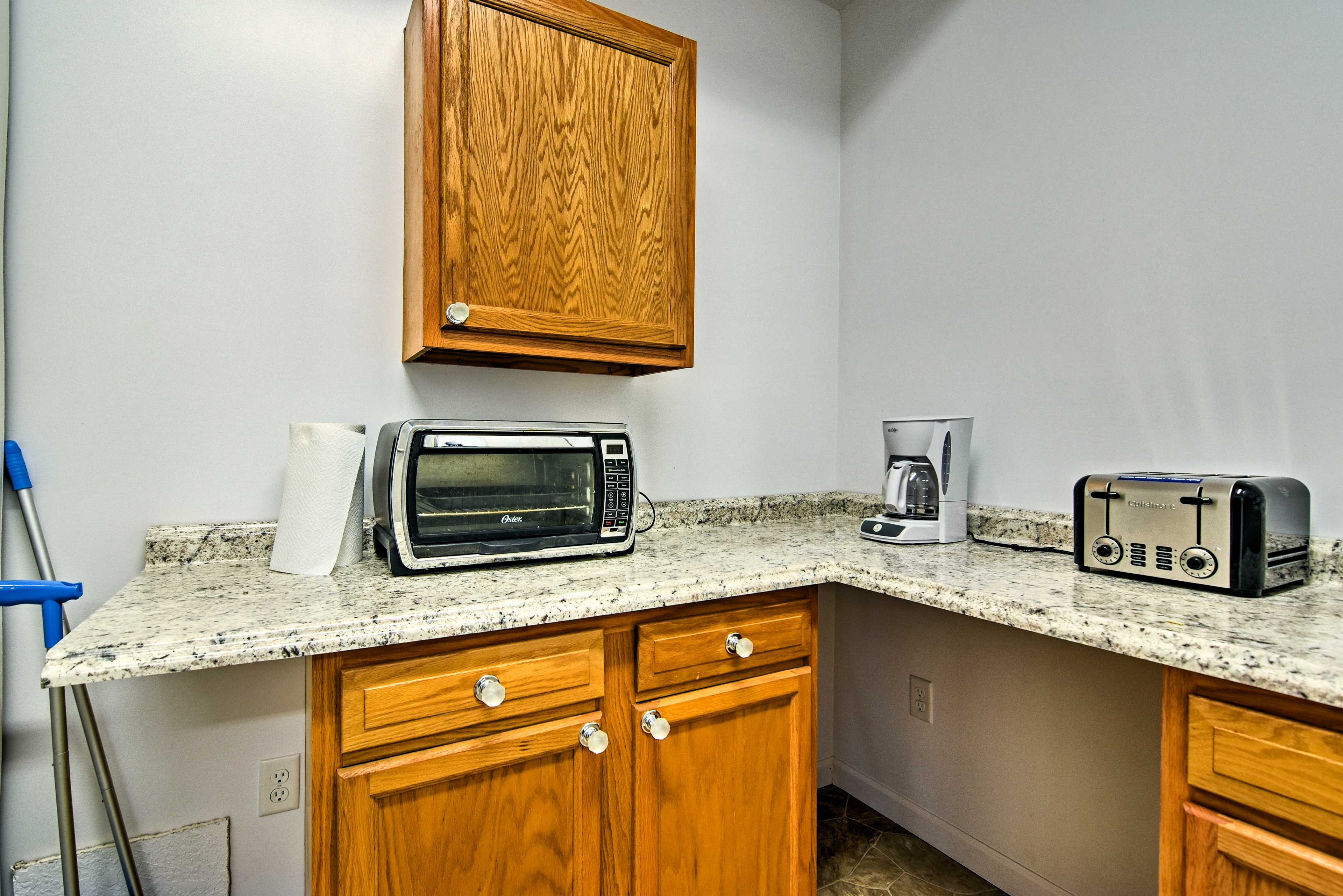 Additional storage space and appliances can be found in the garage.