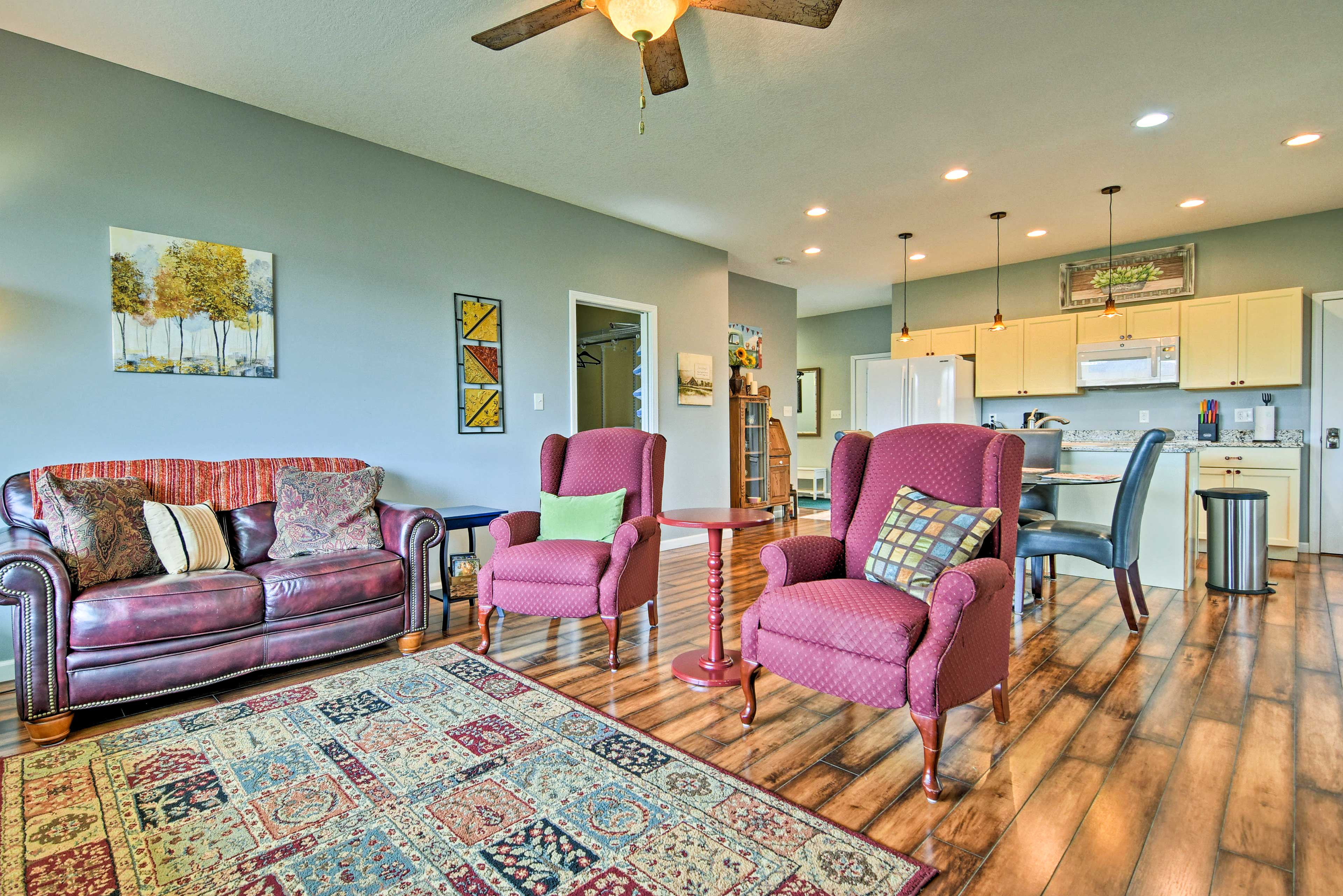 The interior is beautifully finished with hardwood floors and abundant windows.