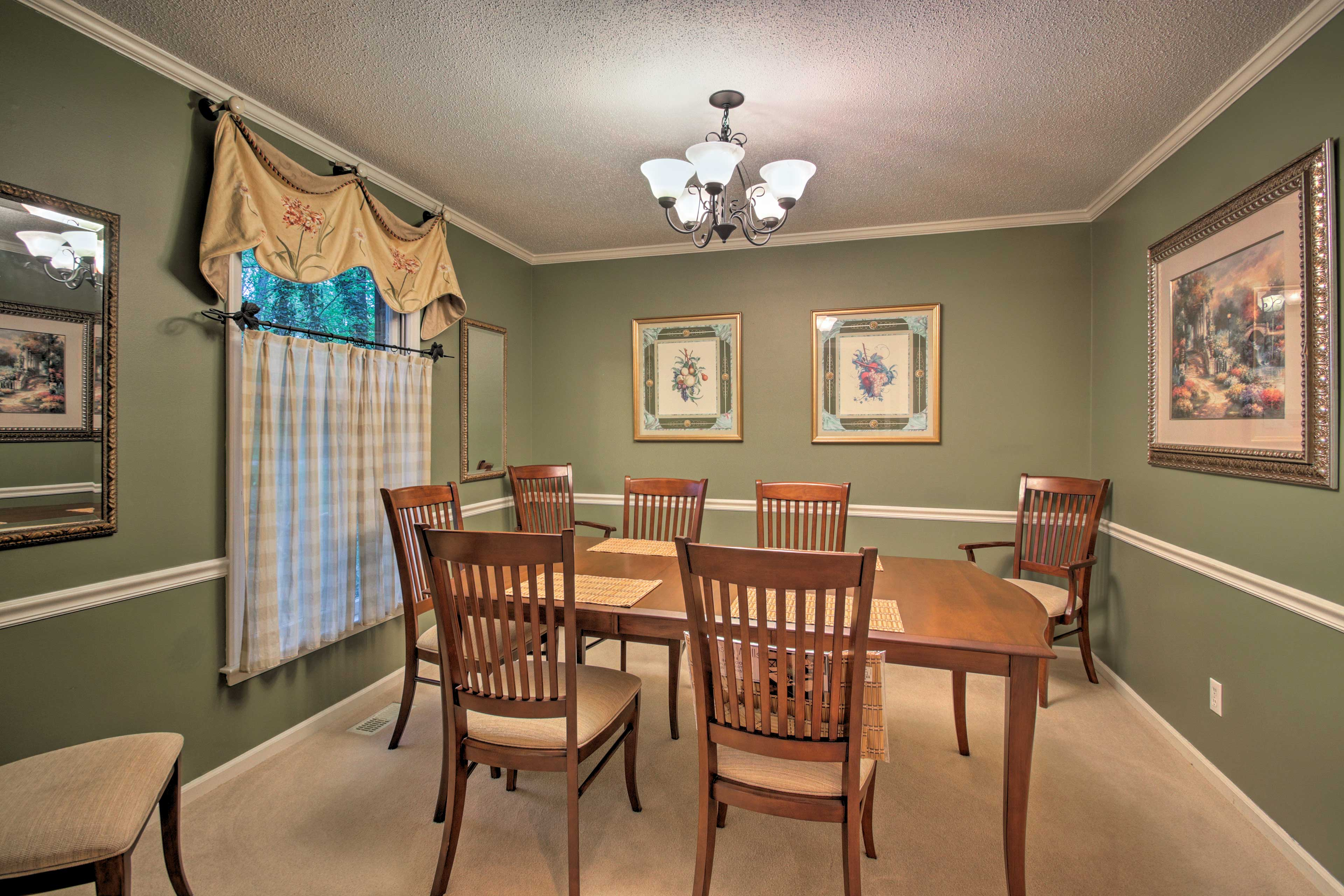 The formal dining space provides seating for 8.