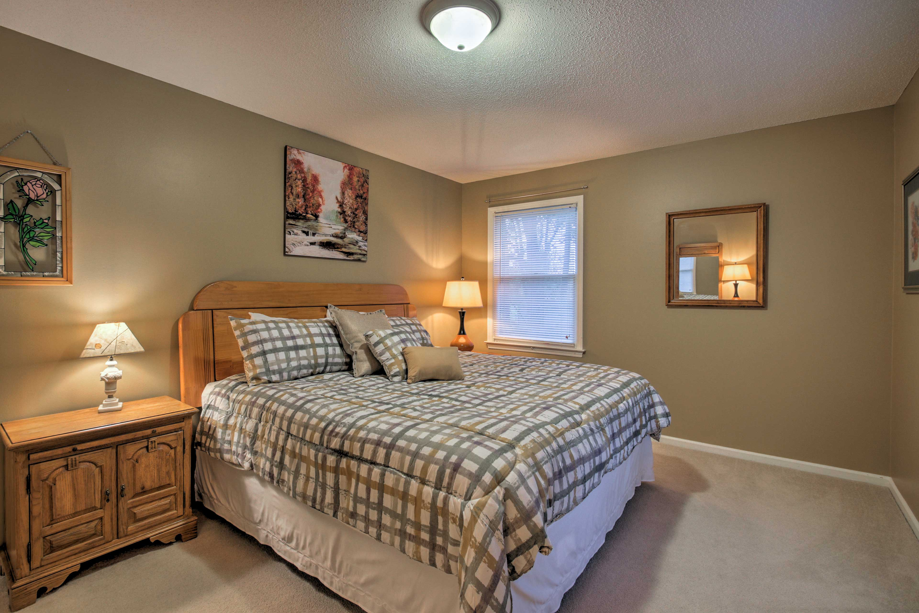 Two travelers can claim the queen bed in this third bedroom.