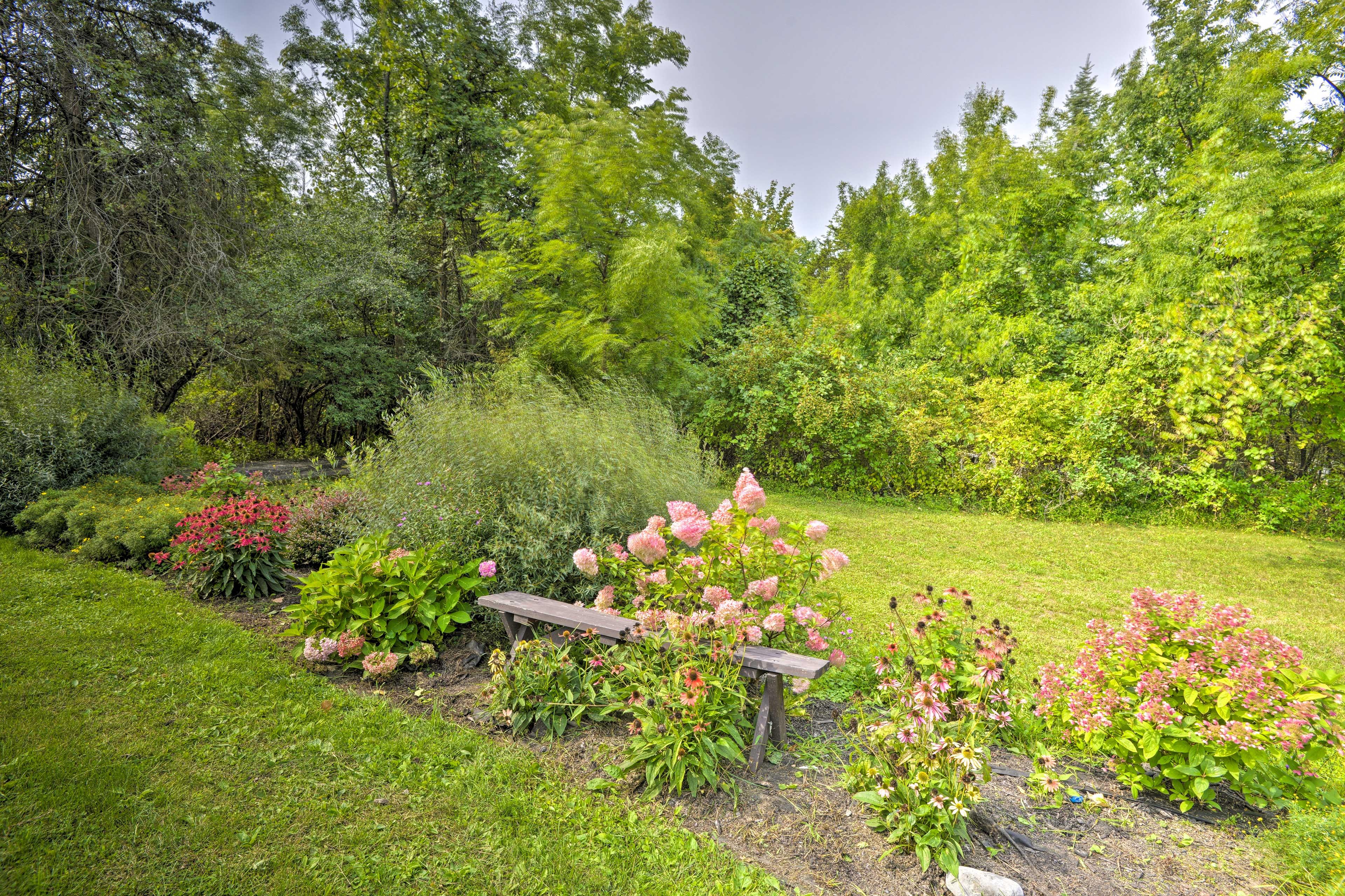 Beautiful gardens surround this scenic abode!