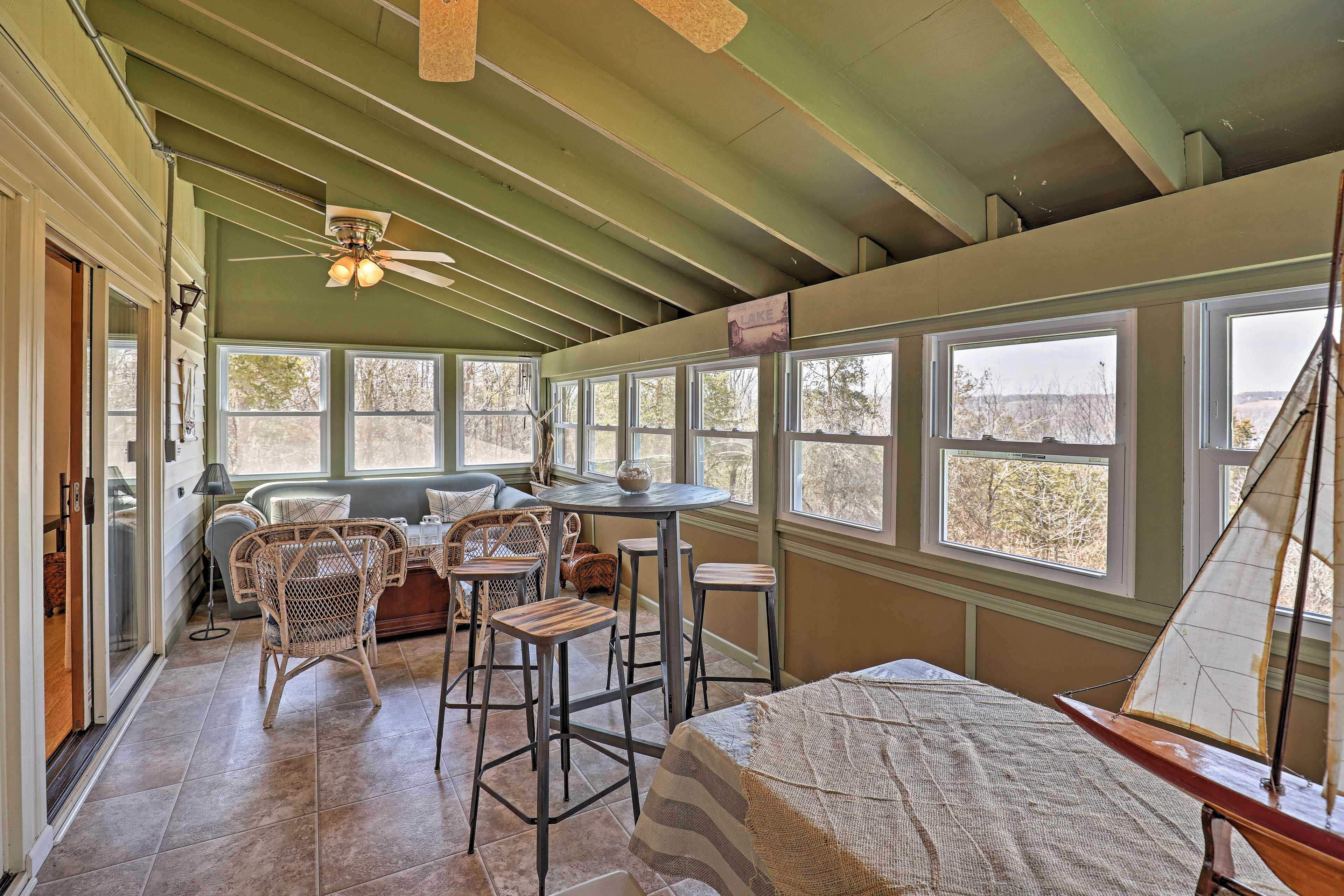 Dine on the screened-in porch.